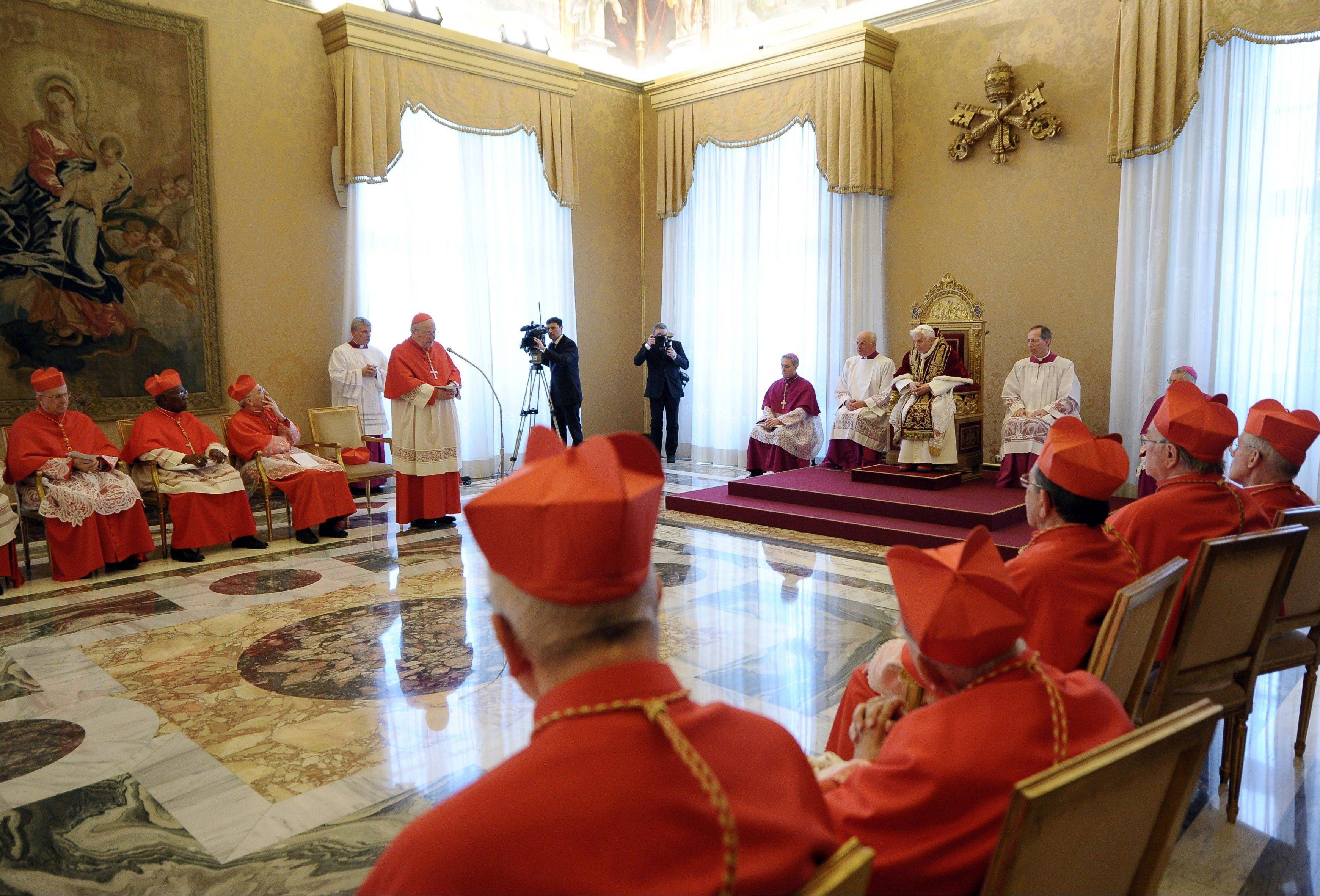 Pope Benedict XVI, sitting on the throne at center-right, attends a meeting of Vatican cardinals at the Vatican.