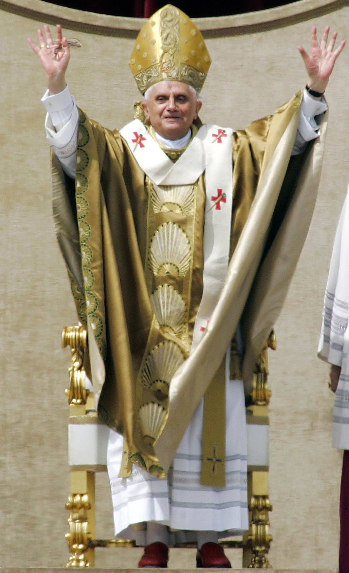 Pope Benedict XVI openshis arms as he celebrates his installment Mass in St. Peter's Square at the Vatican.
