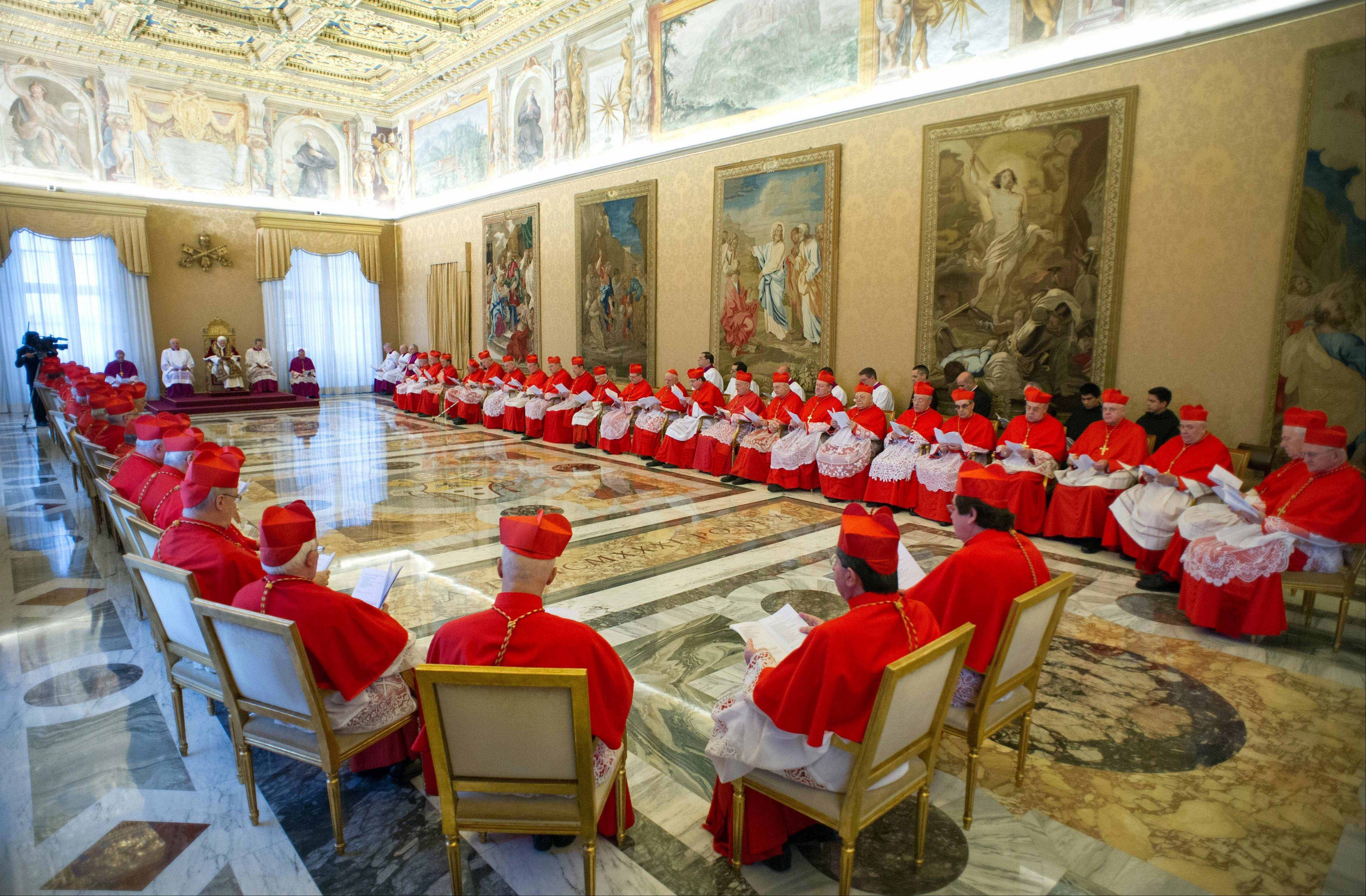 Pope Benedict XVI, sitting on the throne at left, attends a meeting of Vatican cardinals at the Vatican.