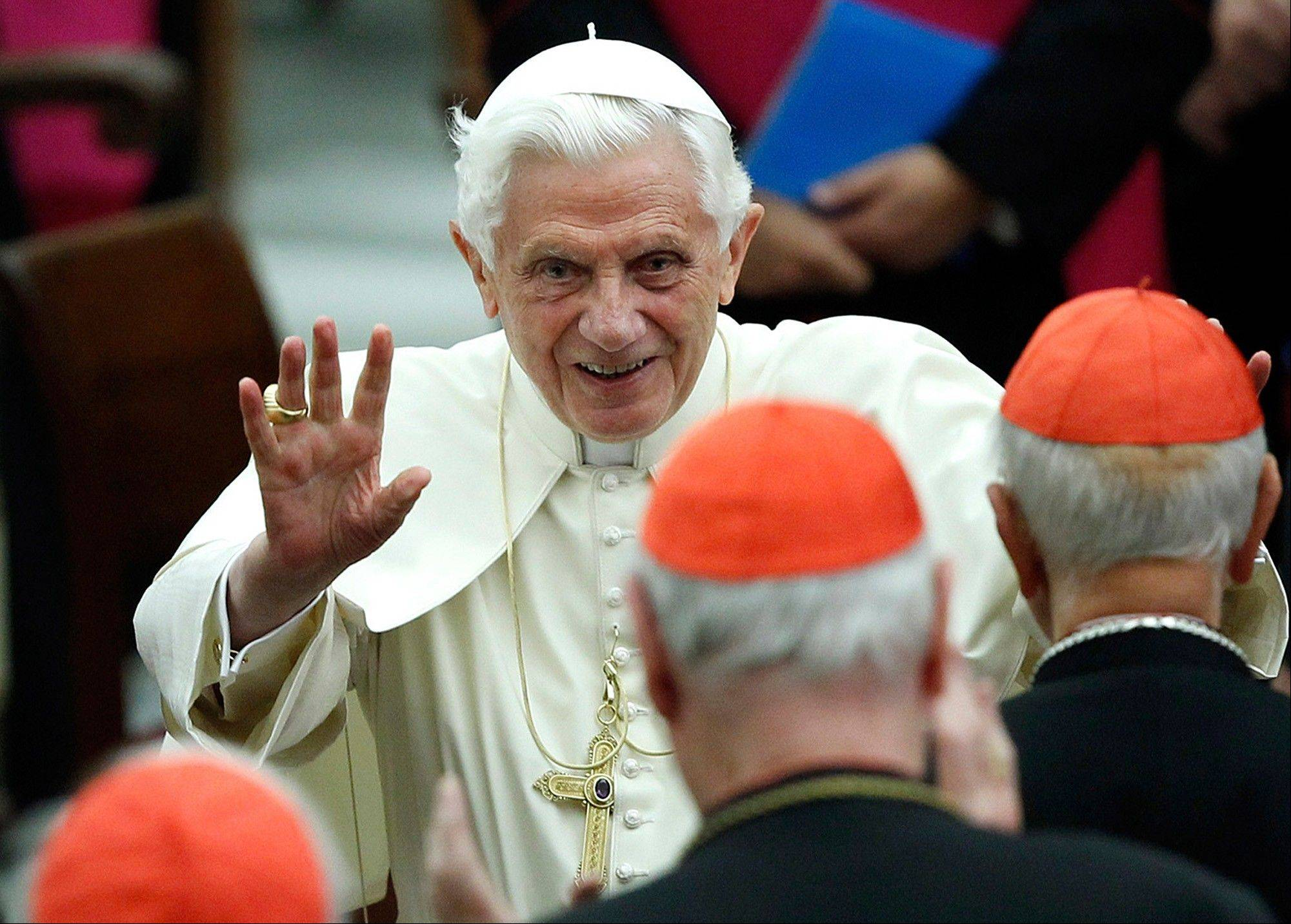 Pope Benedict XVI waves as he leaves Paul VI hall after attending a concert of the Asturias Principality Symphony Orchestra directed by Chilean conductor Maximiano Valdes.