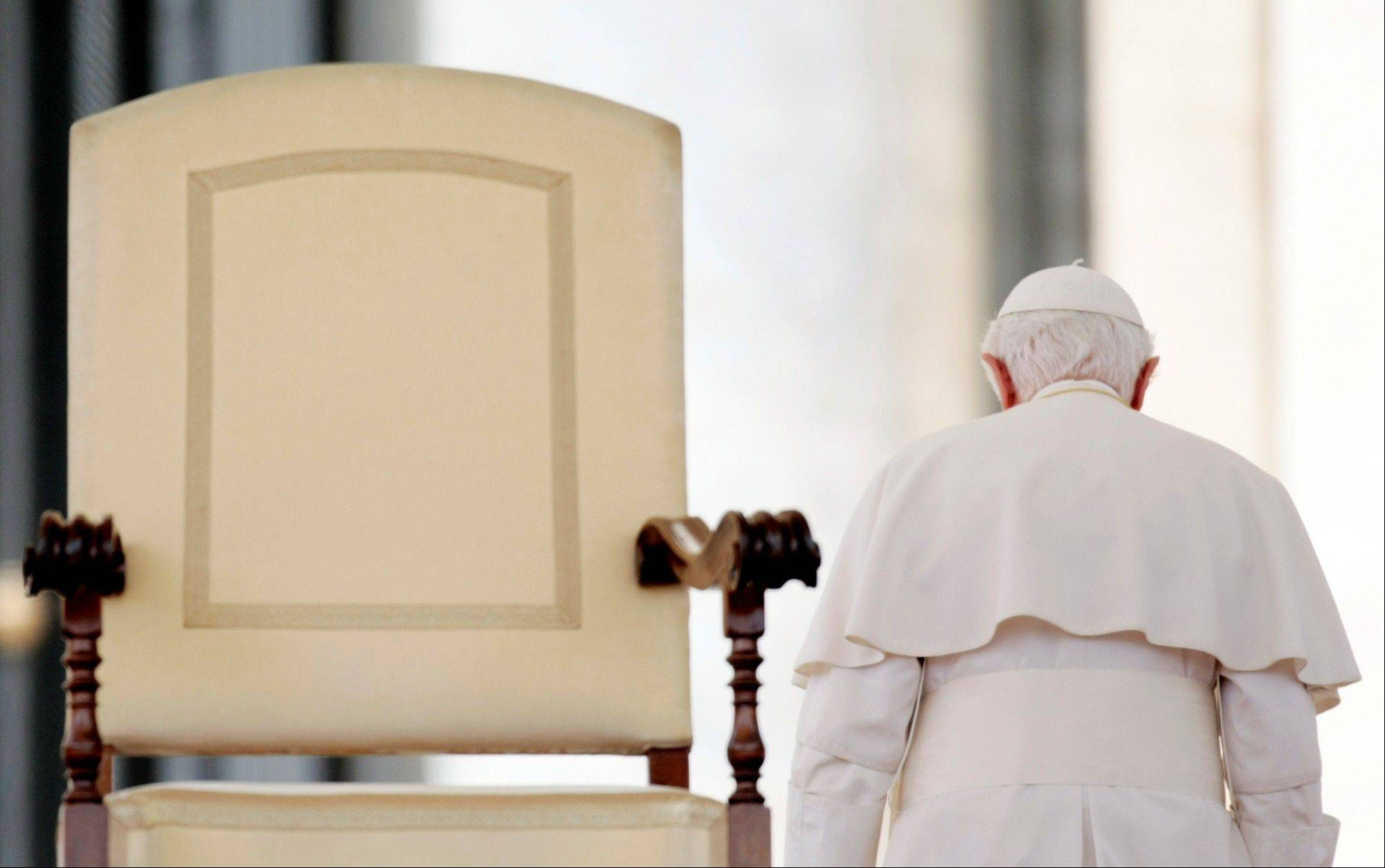 Pope Benedict XVI leaves at the end of his weekly general audience in St. Peter's Square at the Vatican.
