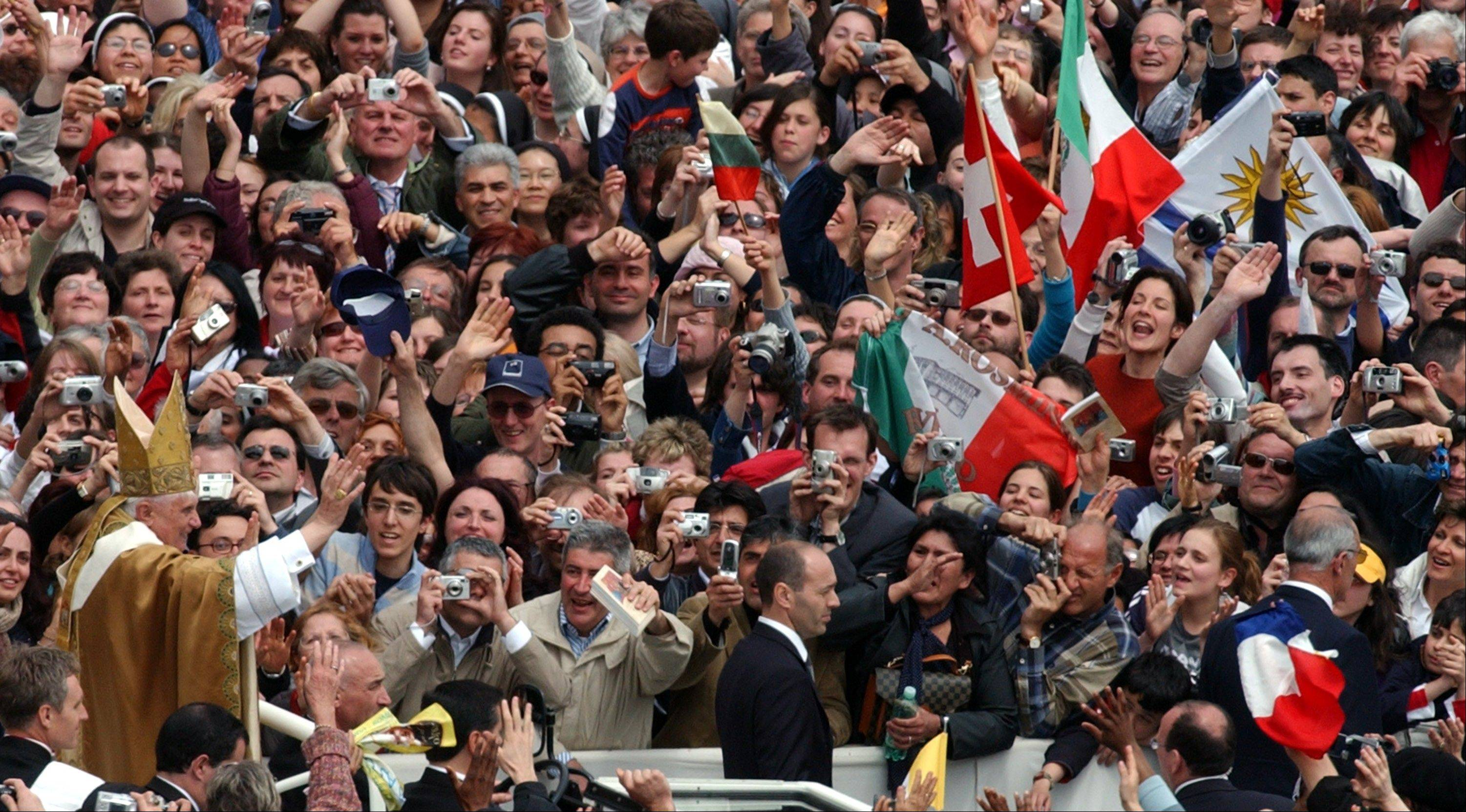 Pope Benedict XVI greets the crowd after celebrating his installation Mass in St. Peter's Square at the Vatican.
