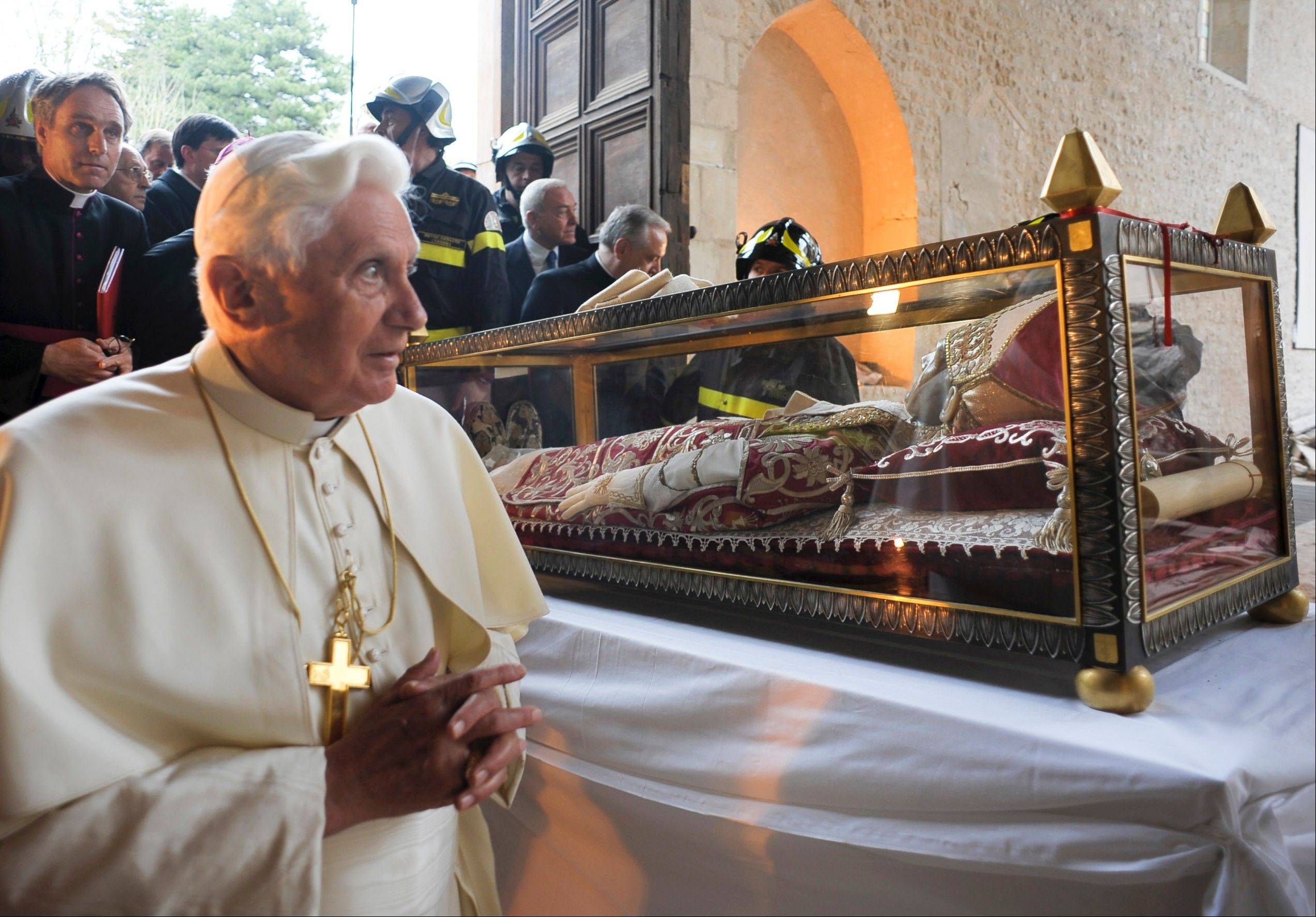 FPope Benedict XVI stands by the salvaged remains of Pope Celestine V in the 13th-century Santa Maria di Collemaggio Basilica, the symbol of the city of L'Aquila.