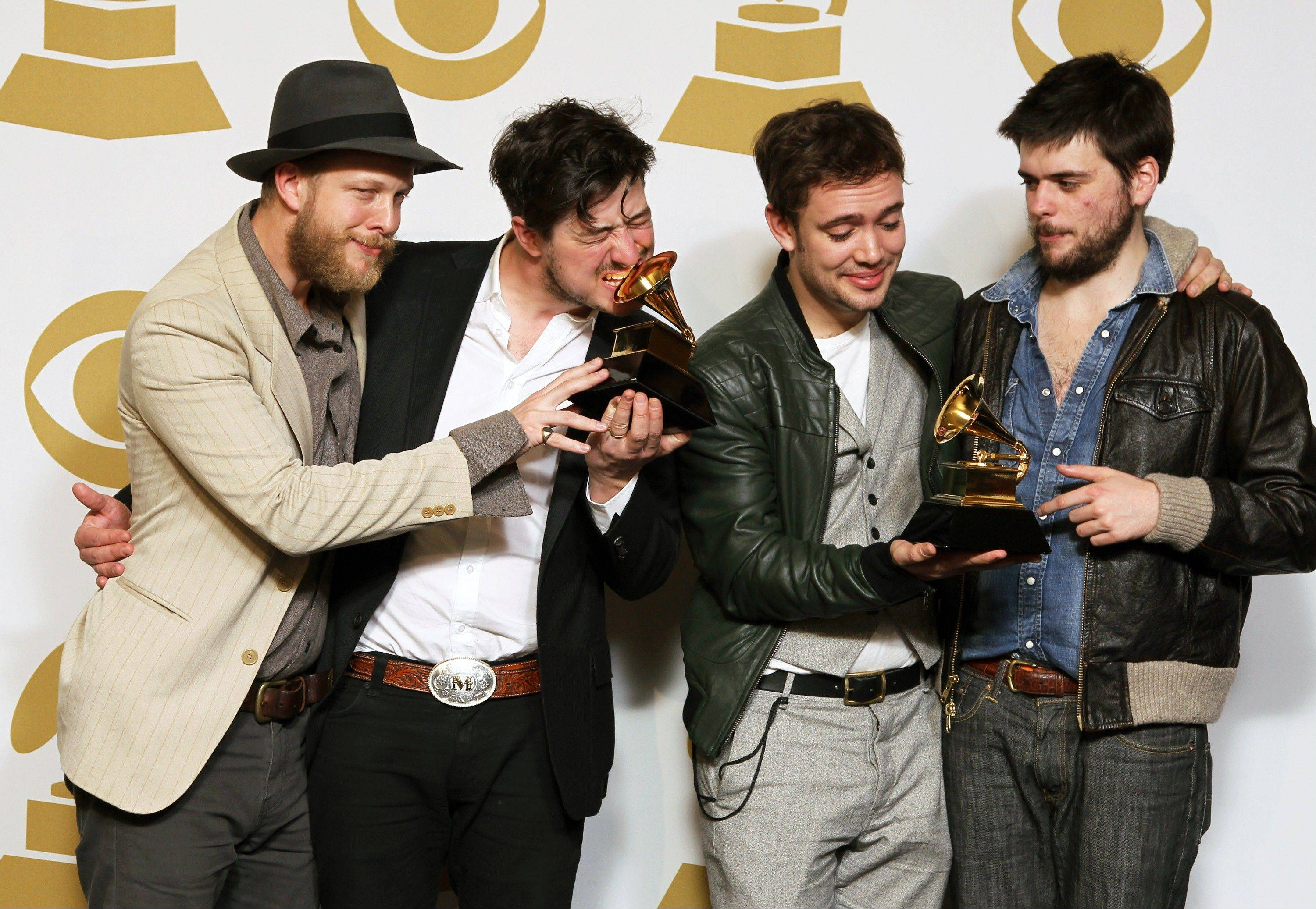 "Members of the musical group Mumford & Sons, from left, Ted Dwane, Marcus Mumford, Ben Lovett and Winston Marshall, pose backstage with the best long form music video award for ""Big Easy Express"" and the album of the year award for ""Babel"" at the 55th annual Grammy Awards on Sunday in Los Angeles."