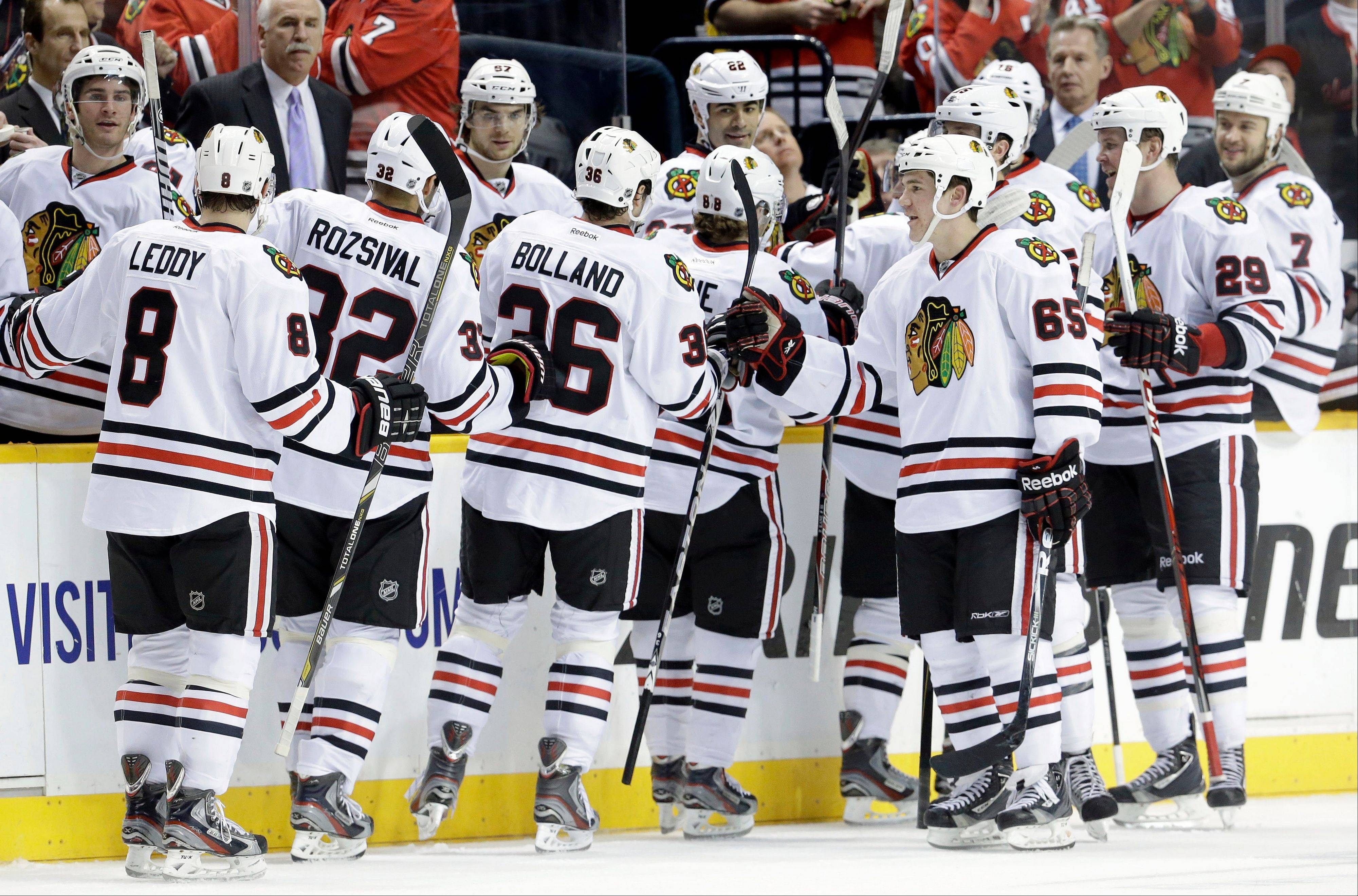 Blackhawks players celebrate a goal by Patrick Kane against the Nashville Predators Sunday during the third period in Nashville, Tenn. The Blackhawks won 3-0.