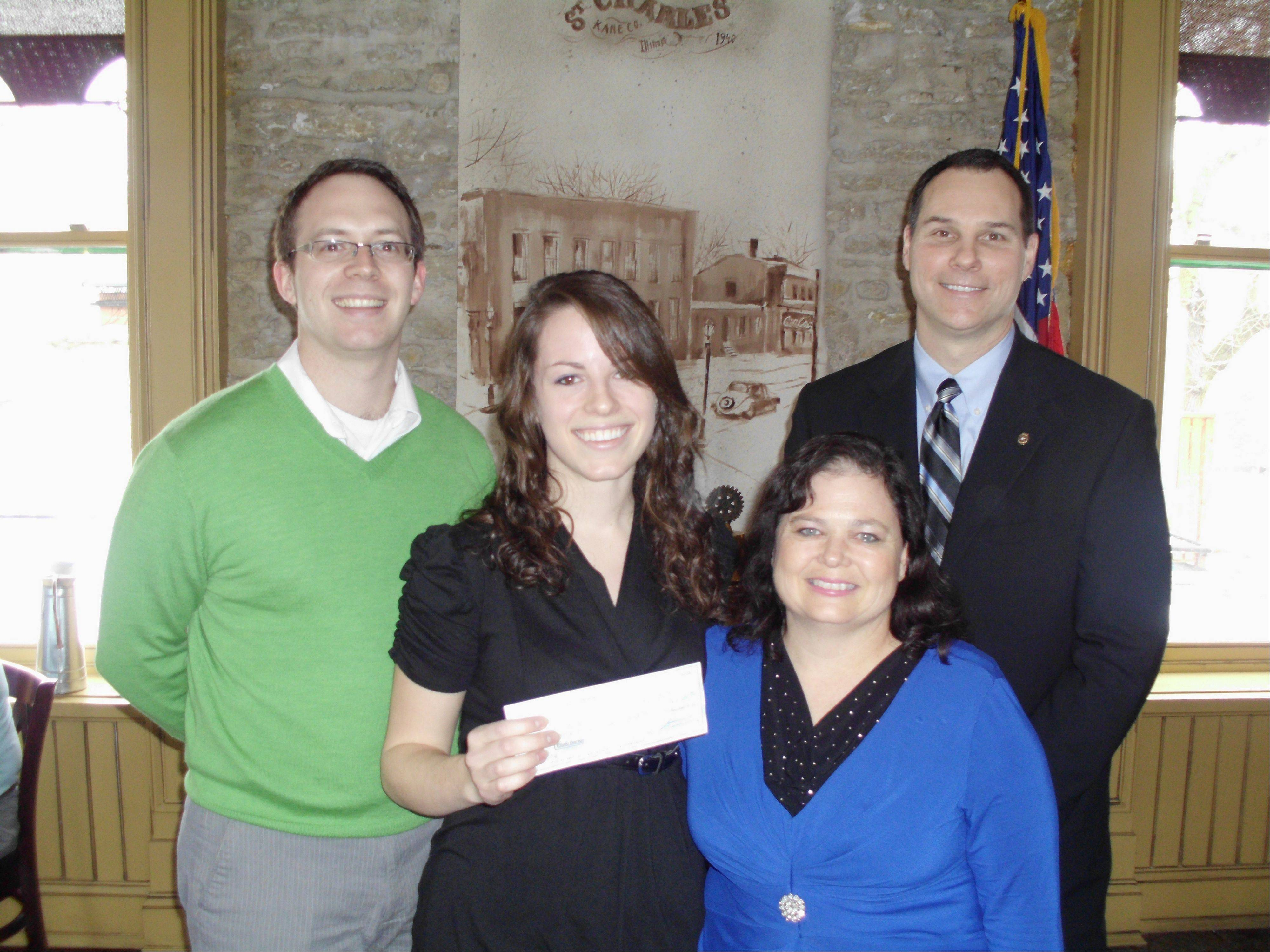 Scholarship winner Mary Kuhn, with her mother, Jennifer Kuhn, receive the $2,500 scholarship check from Scott Piner, left, St. Charles Noon Rotary Club president, and Mark Nyman, St. Charles Noon Rotary Foundation president.