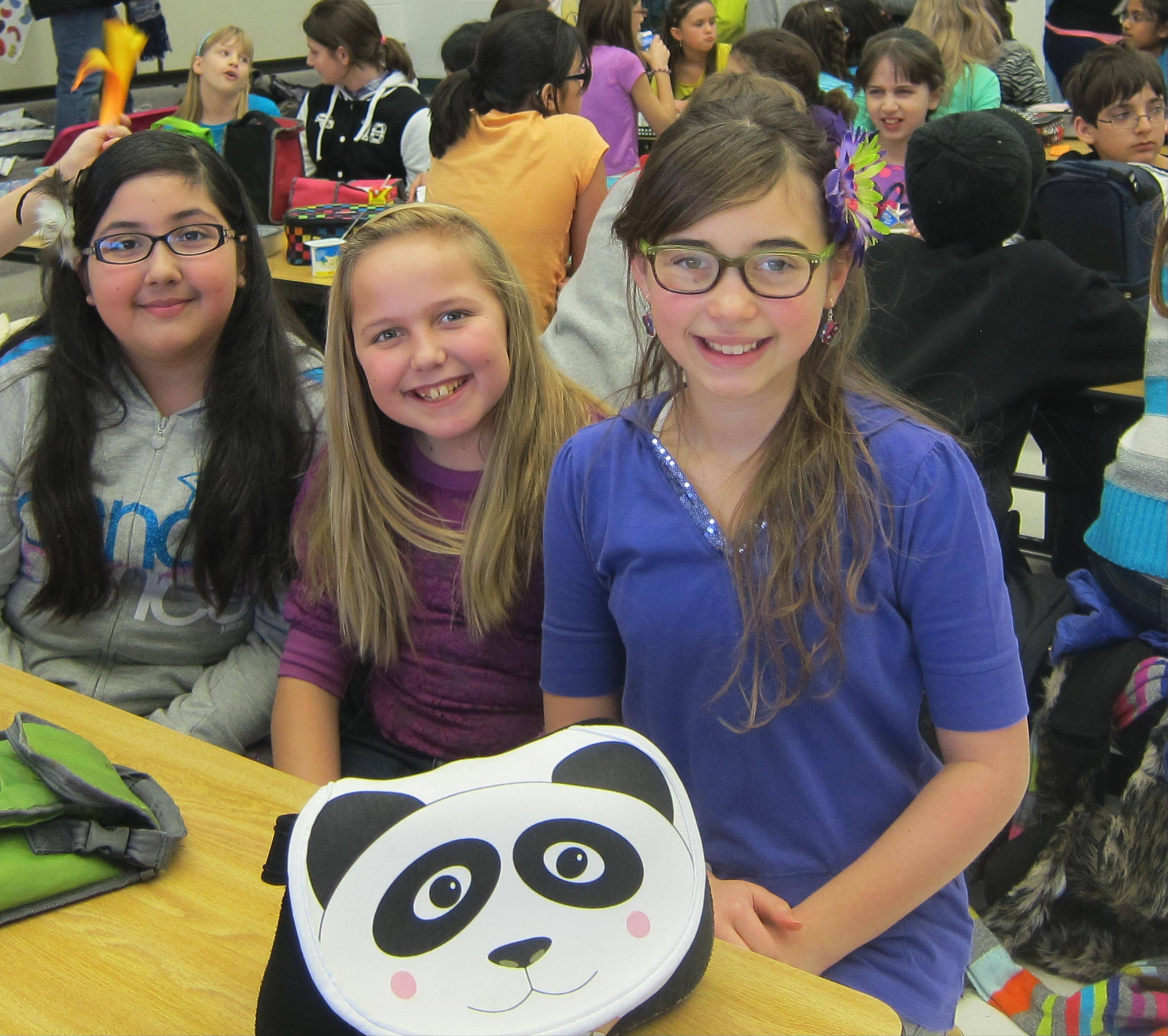 "Gombert Elementary School students Ashley Sanchez, from left, Bethany Bergquist and Marisella Kidd talked about the Naperville READS 2013 book ""Wonder"" after hearing author R.J. Palacio."