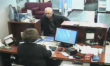 Bank photo of NIles robbery suspect