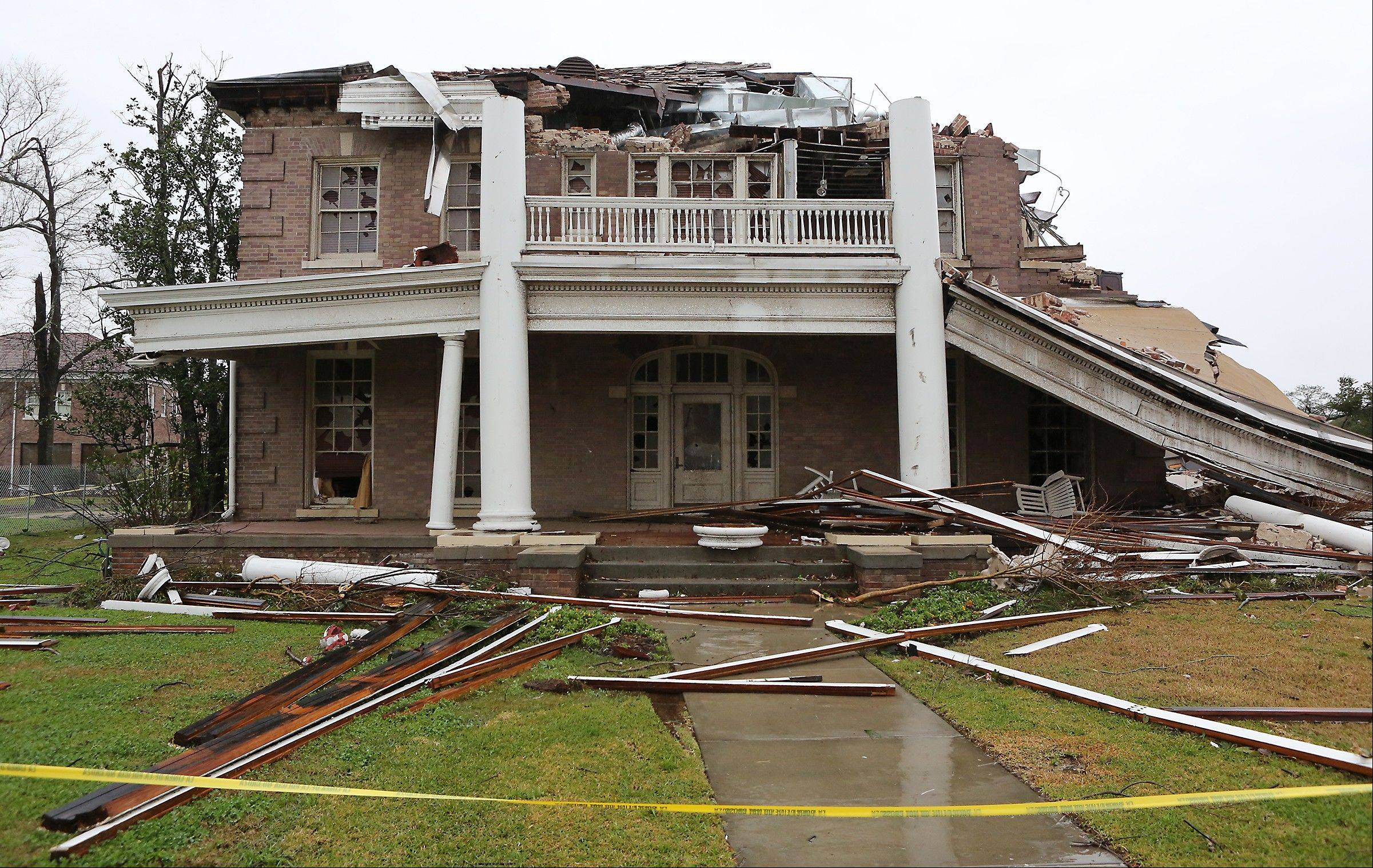 The historic Ogletree Alumni House on the University of Southern Mississippi campus shows heavy damaged Monday, Feb. 11, 2013, the day after an evening tornado ripped through the University of Southern Mississippi and surrounding areas in Hattiesburg, Miss.