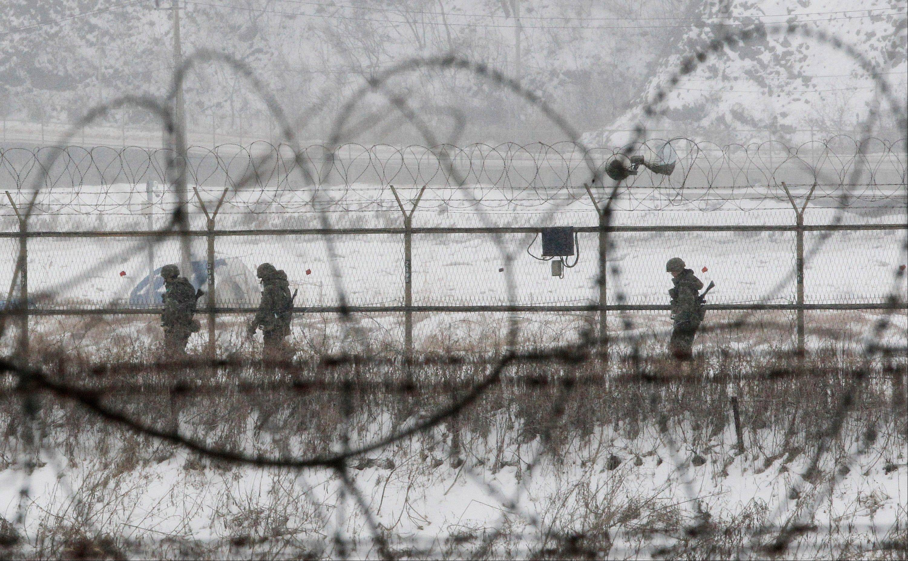 South Korean army soldiers patrol along barbed-wire fences at the Imjingak Pavilion, near the demilitarized zone of Panmunjom, in Paju, South Korea, Tuesday. North Korea tested a nuclear device in defiance of U.N. orders to stop building atomic weapons earlier in the day.