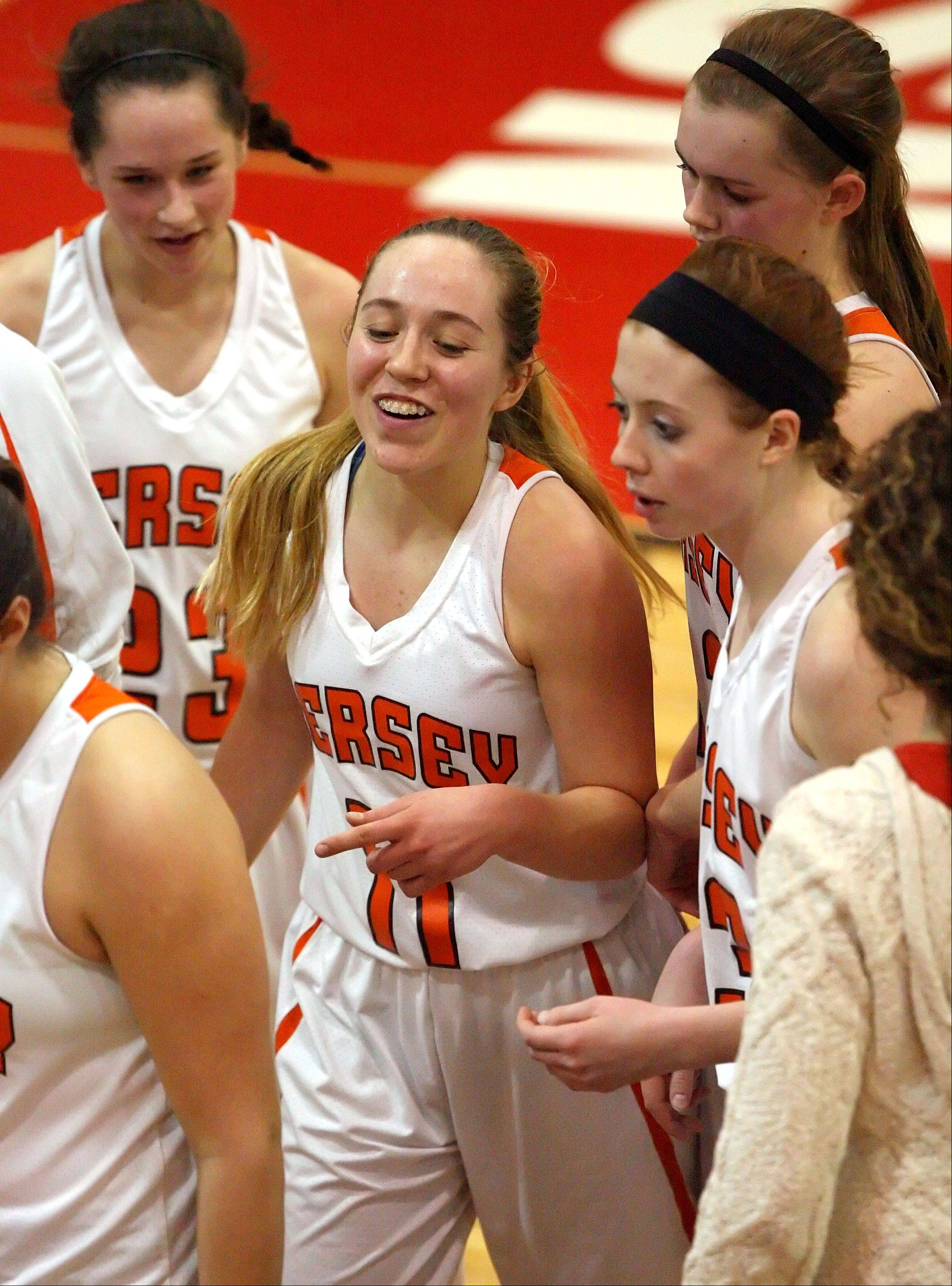 Hersey's Morgan Harris is all smiles as she comes back to the bench during Class 4A regional semifinal play Tuesday night at Mundelein.