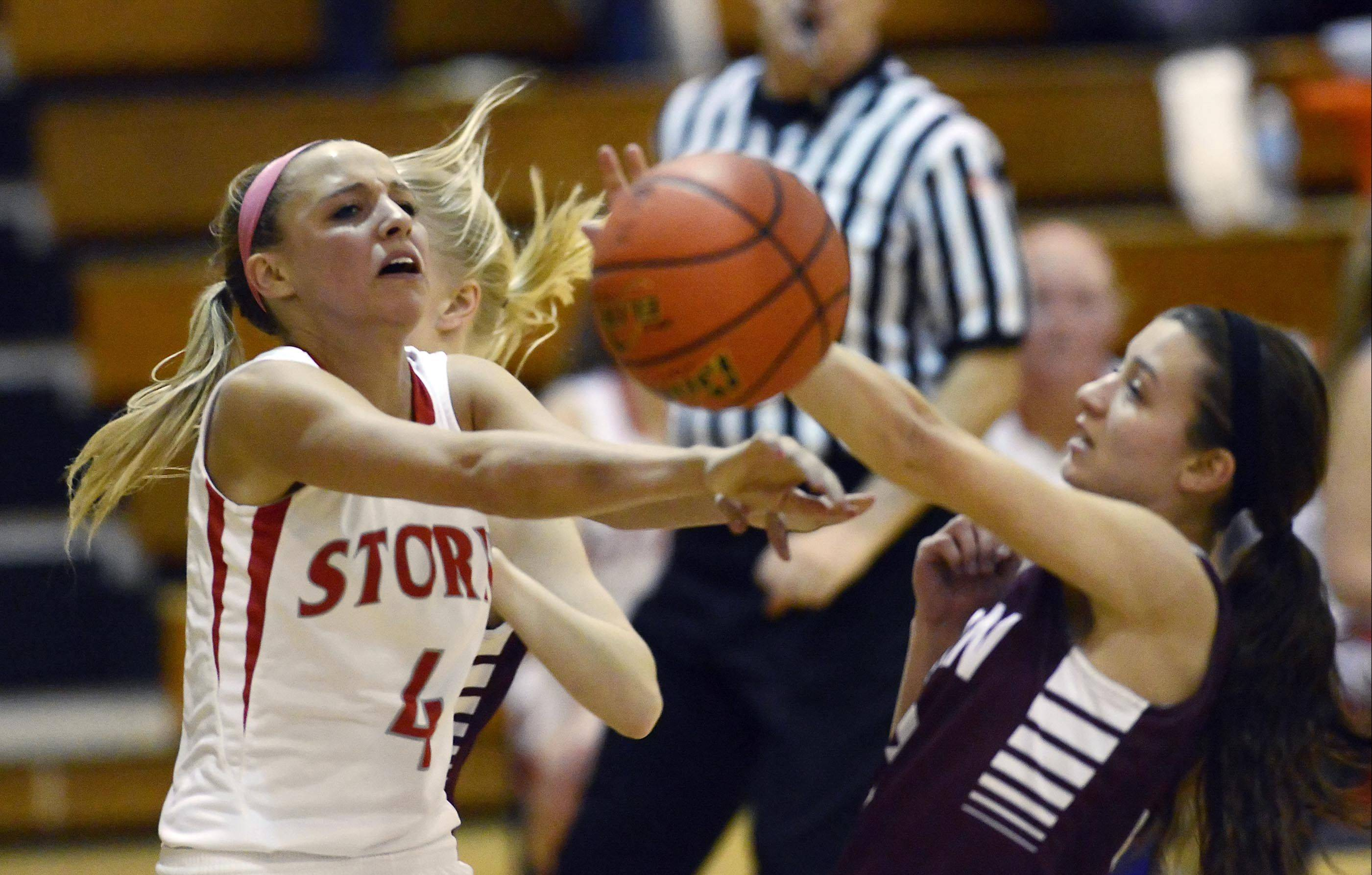 Elgin's Maggie Powers and South Elgin's Savanah Uveges collide as Uveges drives to the basket in Tuesday's Class 4A regional semifinal game in Streamwood.
