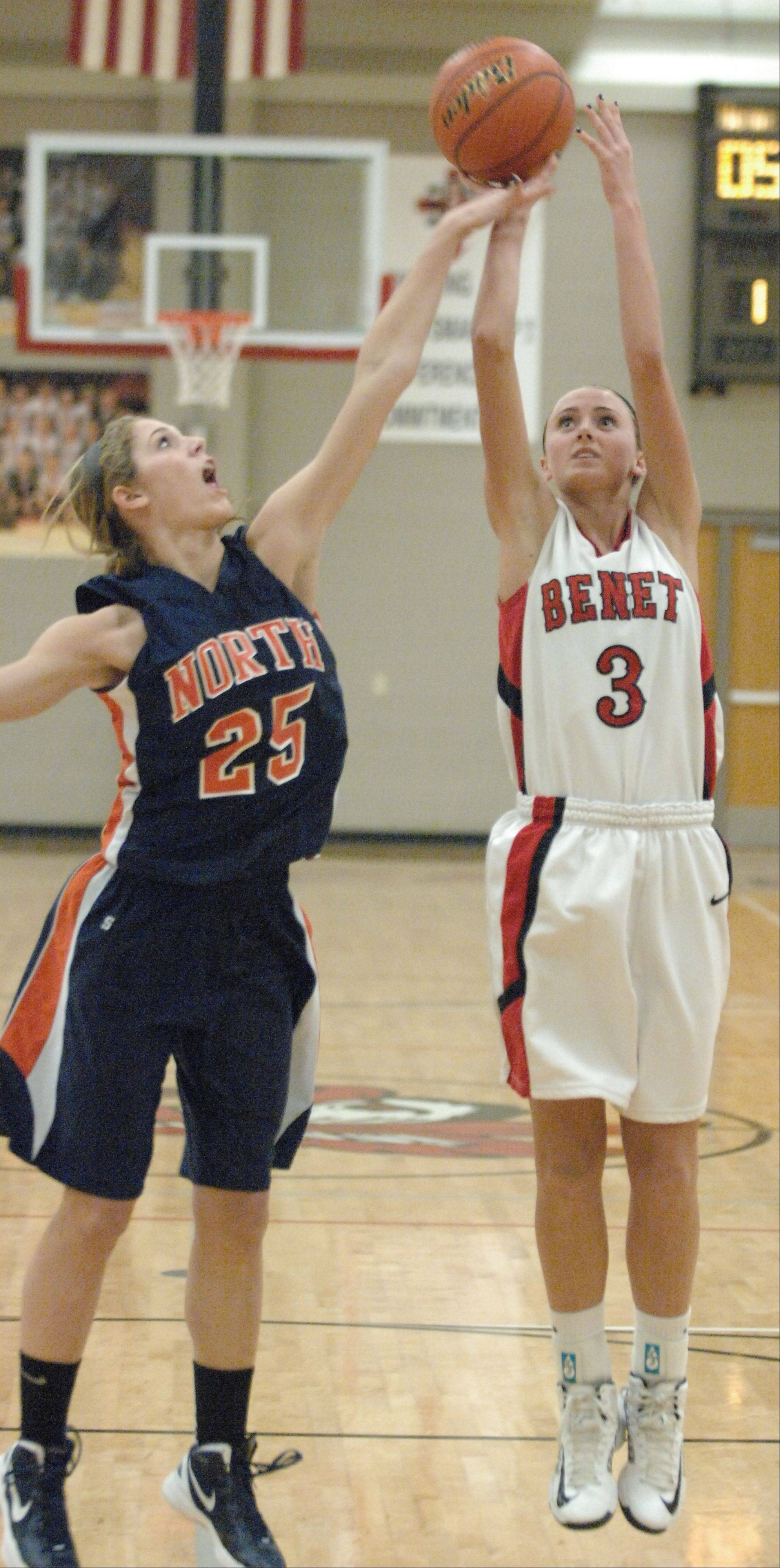 Kayla Sharples of Naperville North and Christen Prasse of Benet go up for a rebound during game action in Lisle Tuesday. This took place during the class 4A regional.