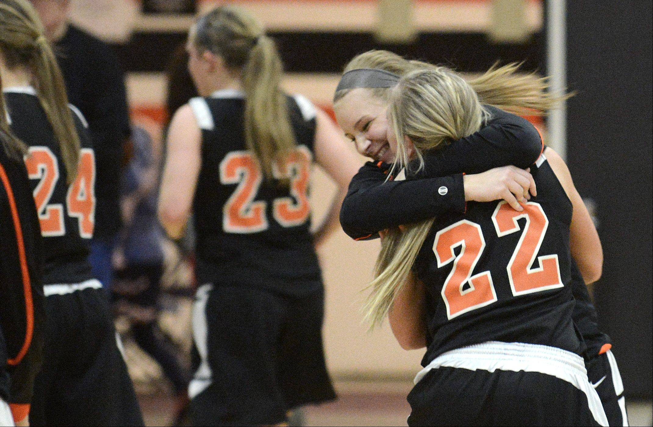 St. Charles East�s Marlena Detzel , facing, embraces teammate Anna Bartels after their win.