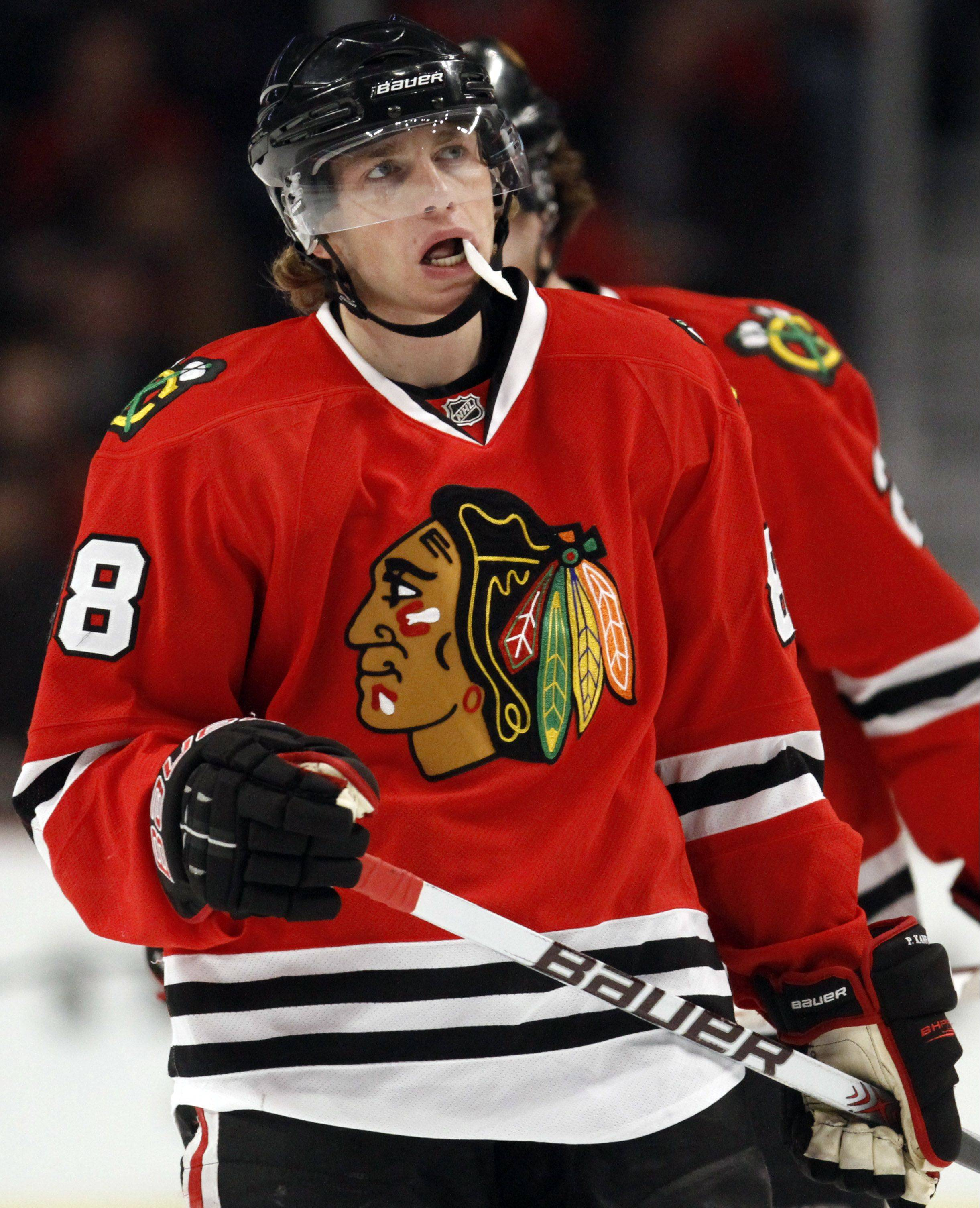 The Hawks' Patrick Kane is pictured here during last season, when he wore a mouth guard. Since playing in Switzerland during the NHL lockout. Kane no longer wears it.