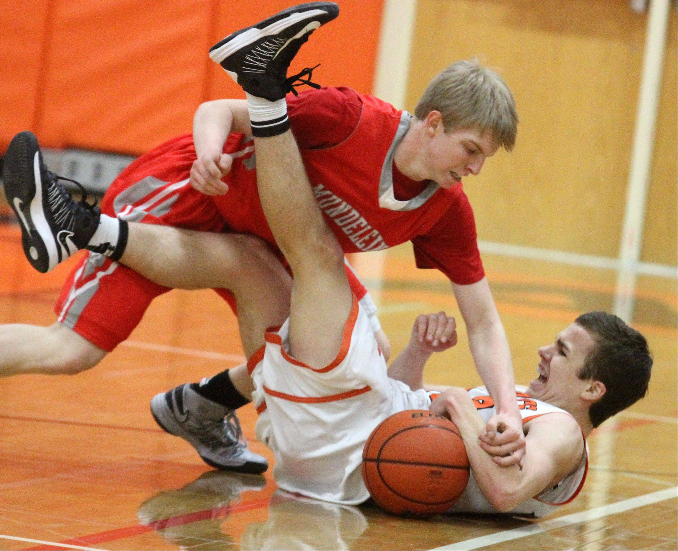 Mundelein�s Dylan Delaquila tries to take the ball from Libertyville�s Nick Carlucci after the two collided during Friday�s game in Libertyville.