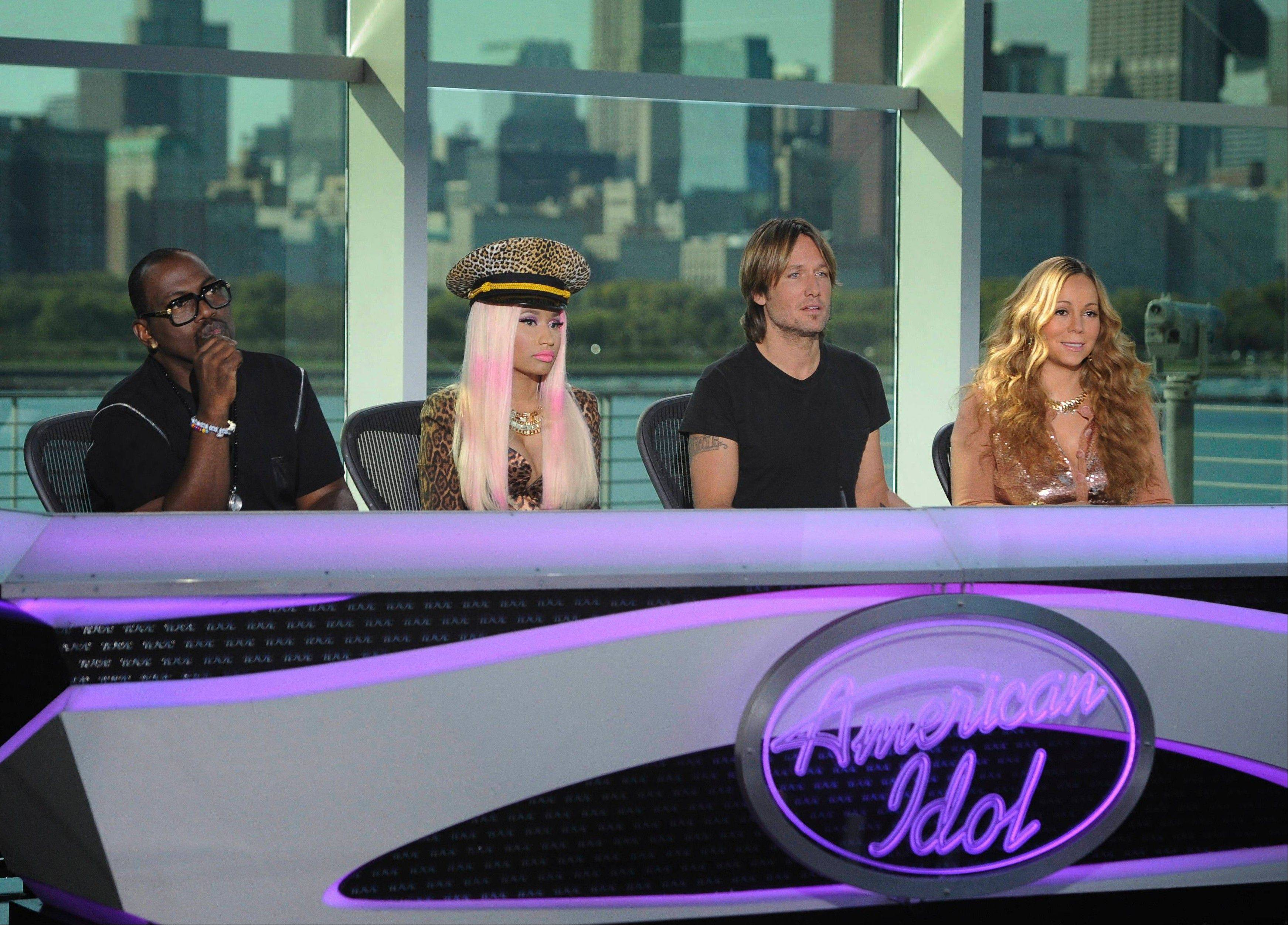 American Idol judges, left to right, Randy Jackson, Nicki Minaj, Keith Urban and Mariah Carey, listen to singers at the show's Chicago auditions last summer.
