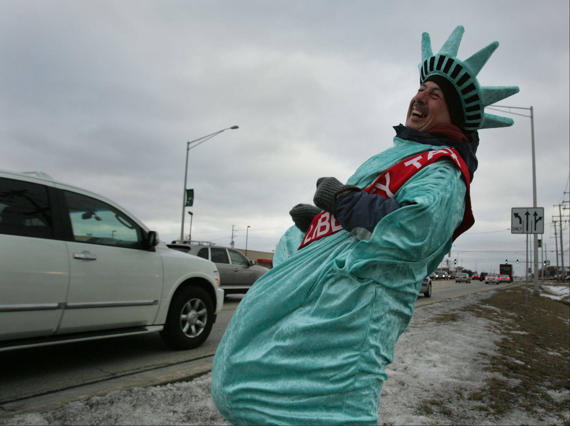Tim Kelly's job is to dress up as the Statue of Liberty and attract drivers' attention, in the hopes they'll consider Liberty Tax Service for their tax preparation needs.