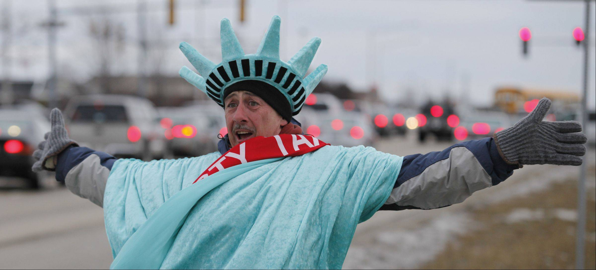 Tim Kelly works for Liberty Tax and says he enjoys acting like a goof while wearing the Statue of Liberty costume.