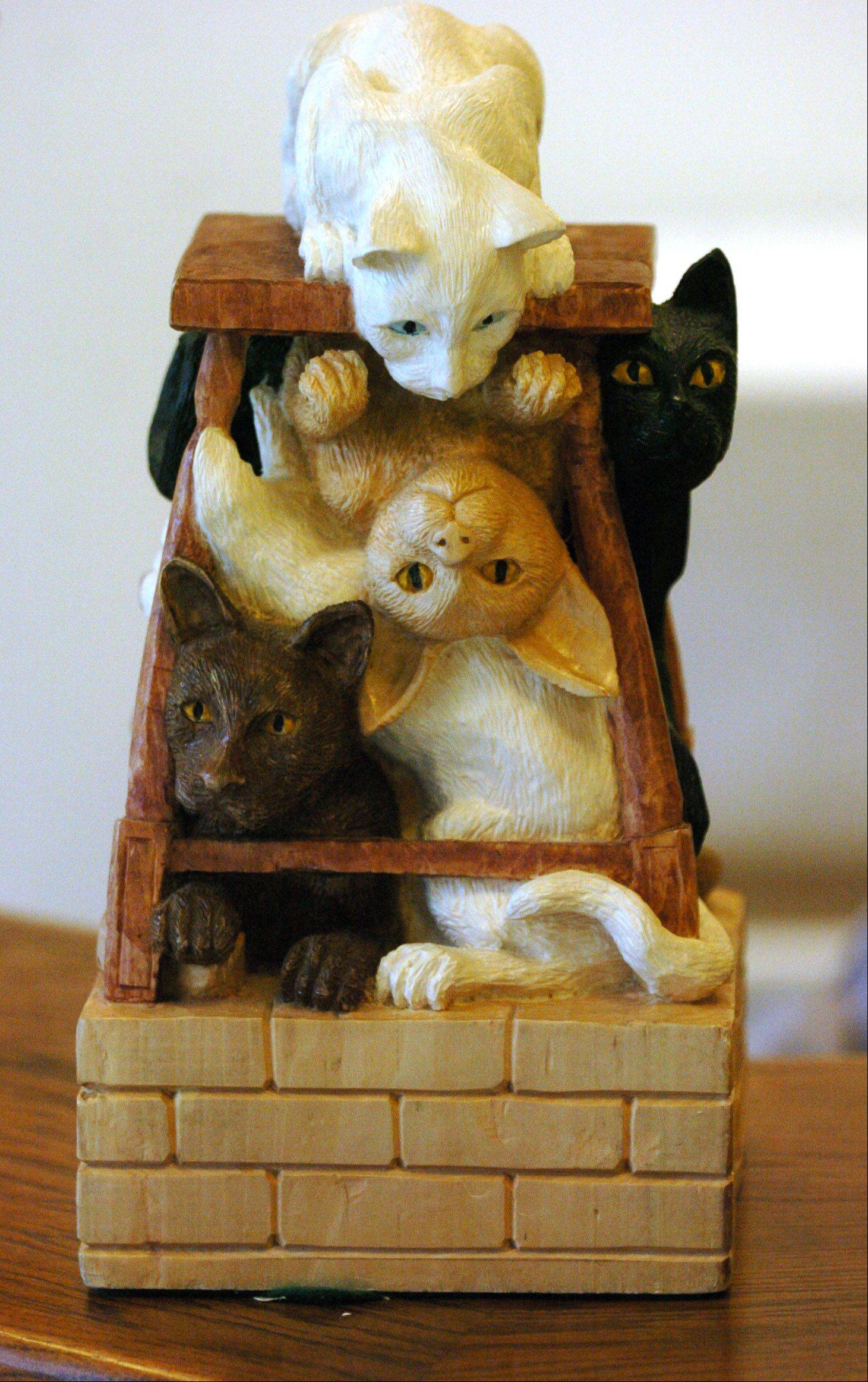 A playful wood carving of cats, done by Shelly Weiser of Naperville. Similar works will be on display and sale at the Winter Wood Wonders Festival this weekend in St. Charles.