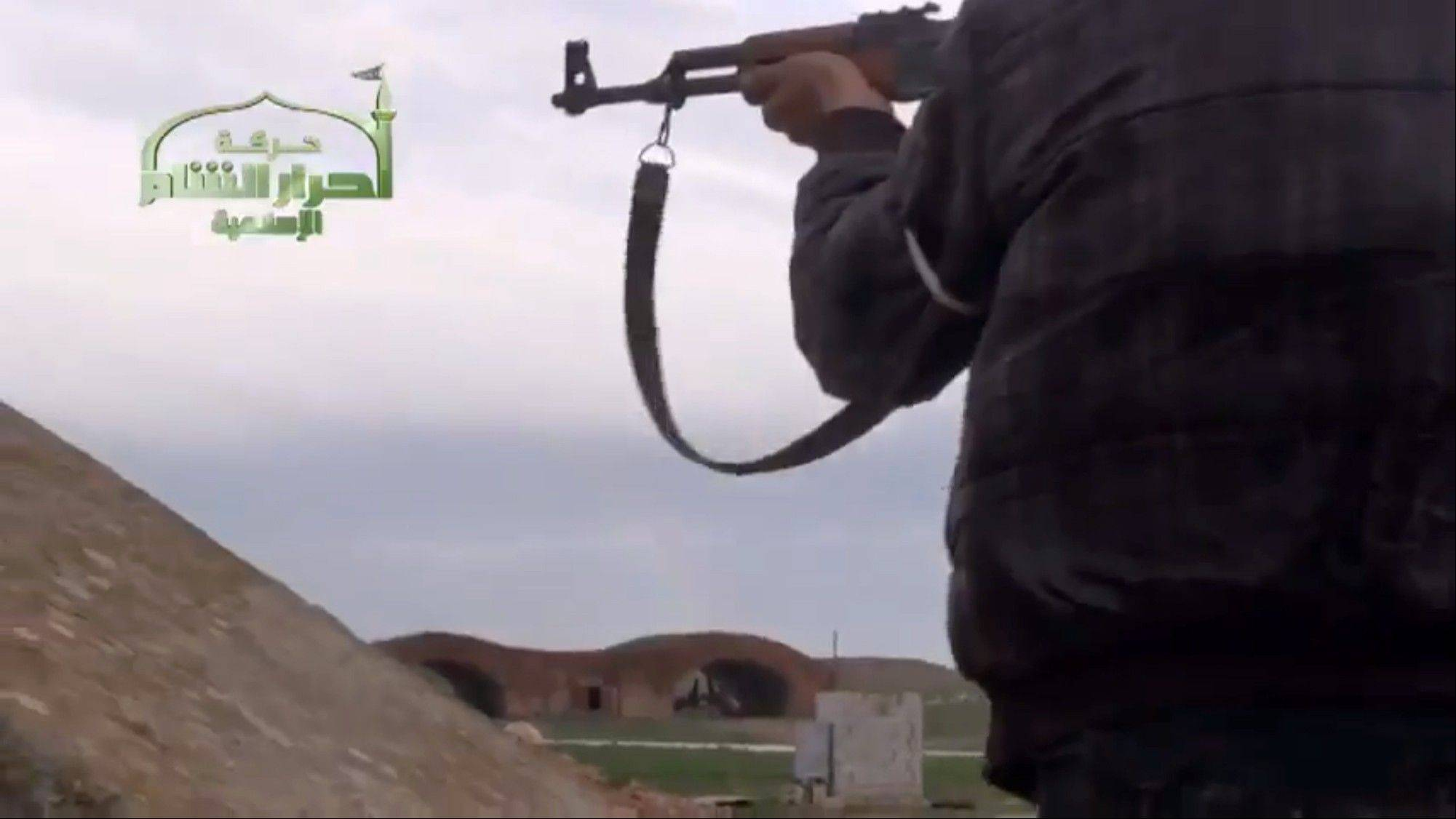 This image taken from video obtained from Ugarit News, which has been authenticated based on its contents and other AP reporting, shows Syrian rebels at Jarrah airfield in Aleppo province, Tuesday, Feb. 12, 2013. Rebels captured a military air base in northern Syria on Tuesday, their second major strategic victory in as many days, activists said.