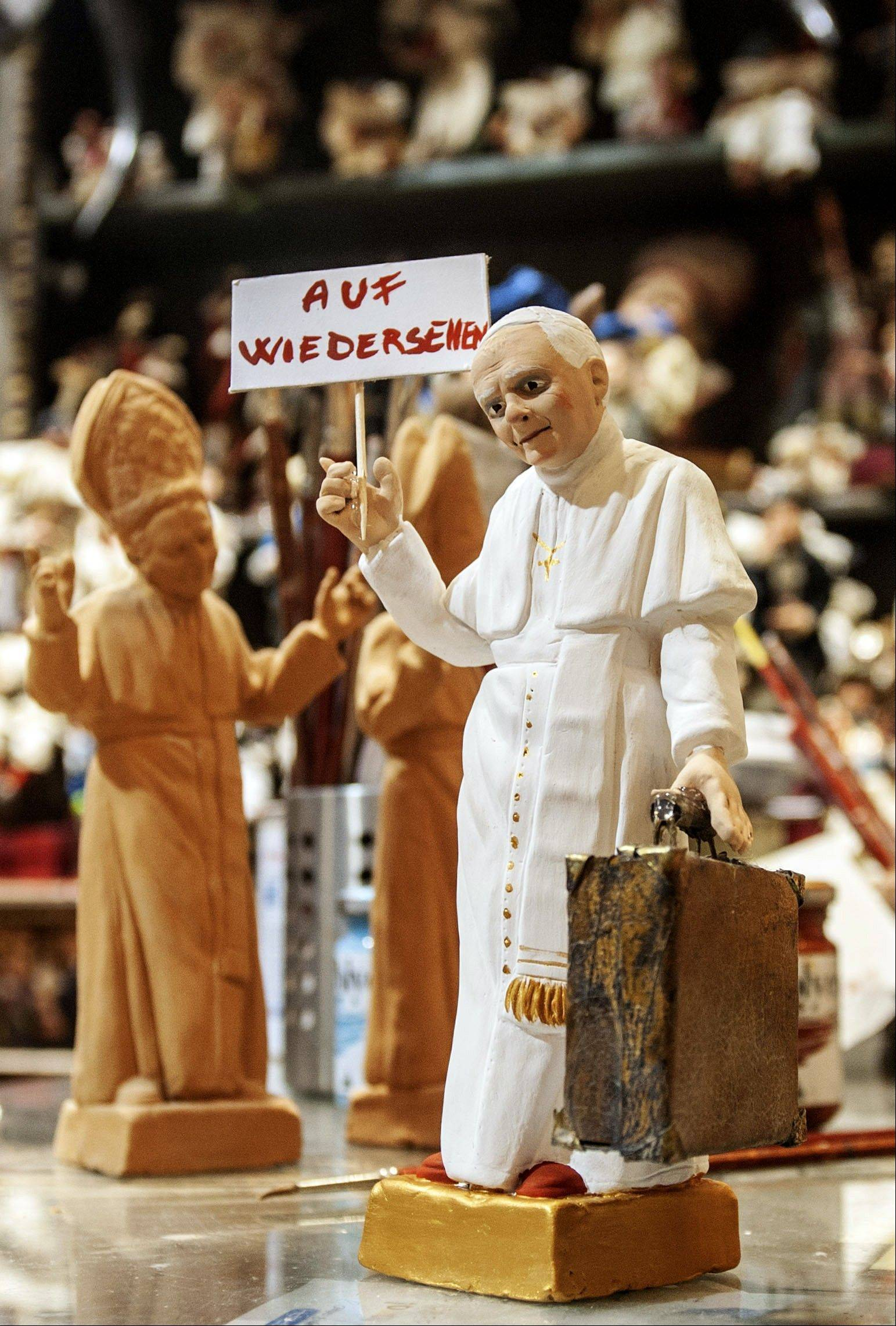 "A statuette depicting Pope Benedict XVI carrying a suitcase and holding up a sign reading in German ""Auf Wiedersehen"" (goodbye), is seen in a shop in Naples, Italy, Feb. 12, 2013. Benedict XVI on Monday announced that he will resign on Feb. 28 -- the first pontiff to do so in nearly 600 years."