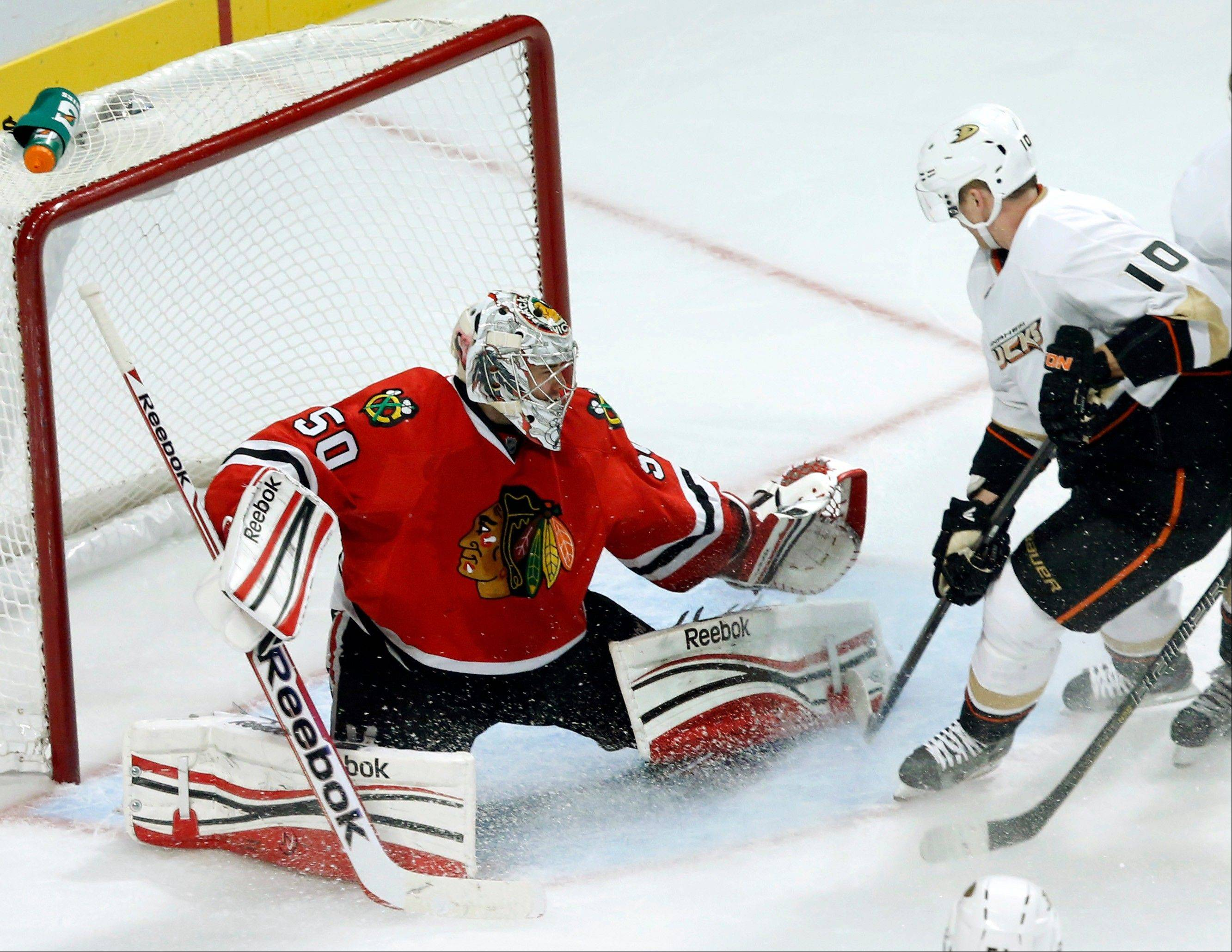 Blackhawks goalie Corey Crawford makes a save on a rebound attempt by Anaheim Ducks right wing Corey Perry during the second period Tuesday night at the United Center.
