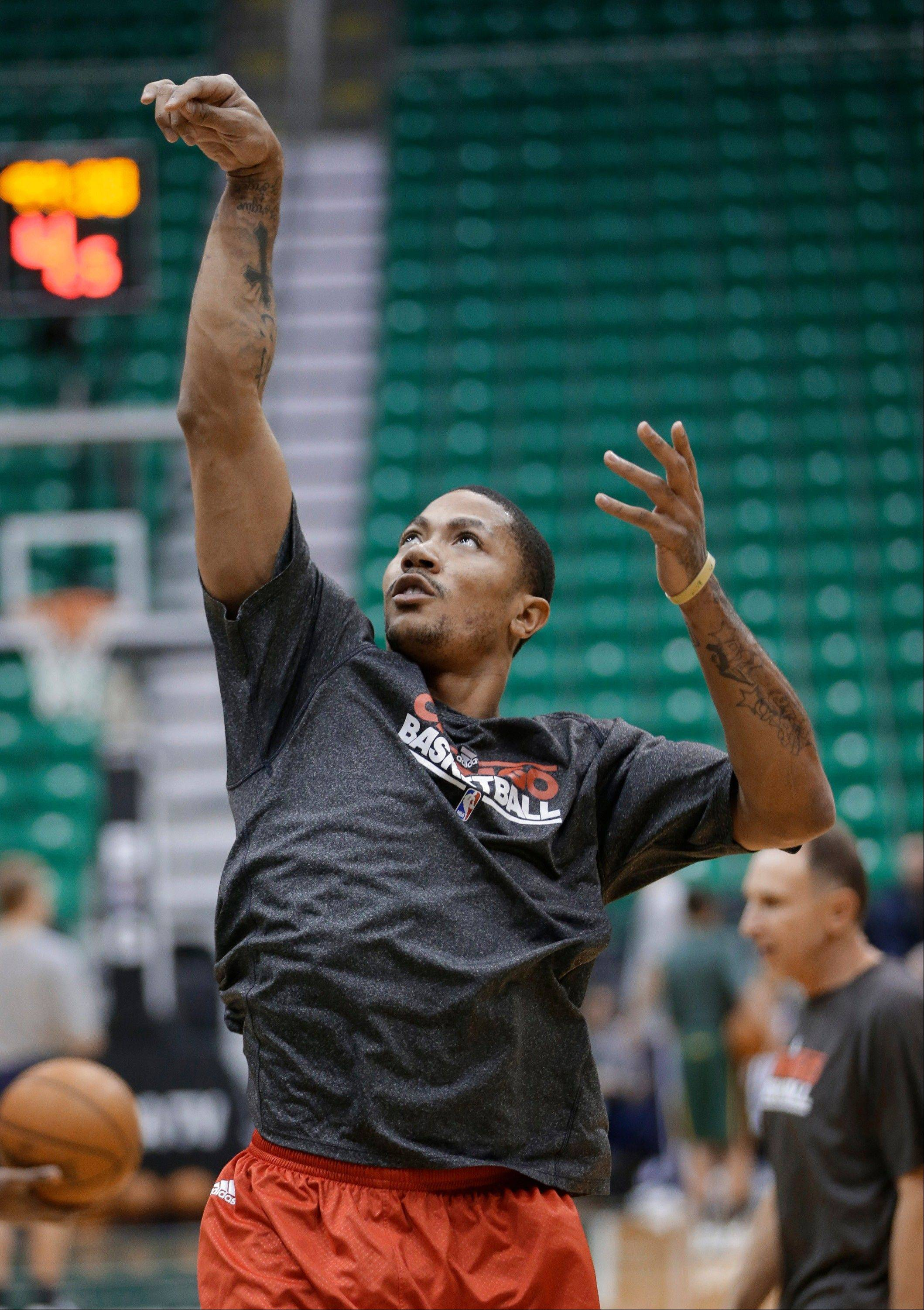 Derrick Rose, here working out before the Bulls' game at Utah last Friday, says he will not rush his return.