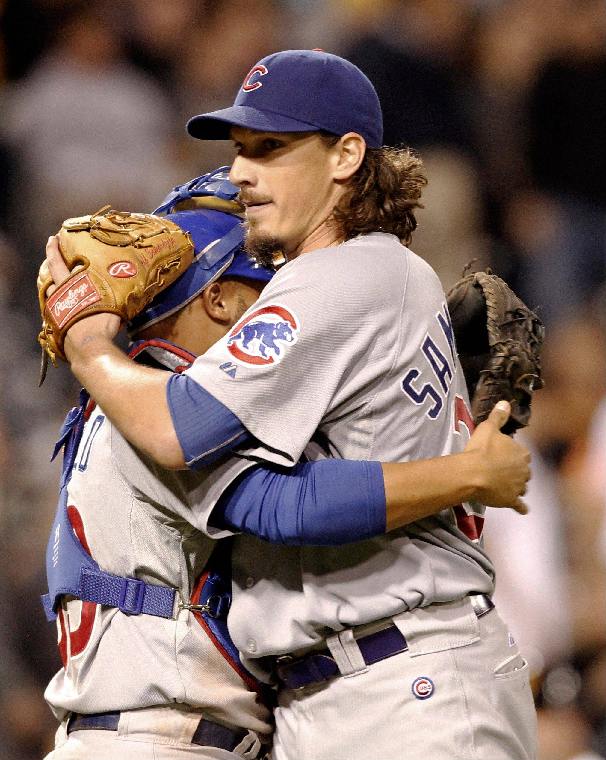 Chicago Cubs starting pitcher Jeff Samardzija, right, hugs catcher Welington Castillo after a baseball game against the Pittsburgh Pirates in September in Pittsburgh. Samardzija threw a complete game as the Cubs beat the Pirates 4-3.