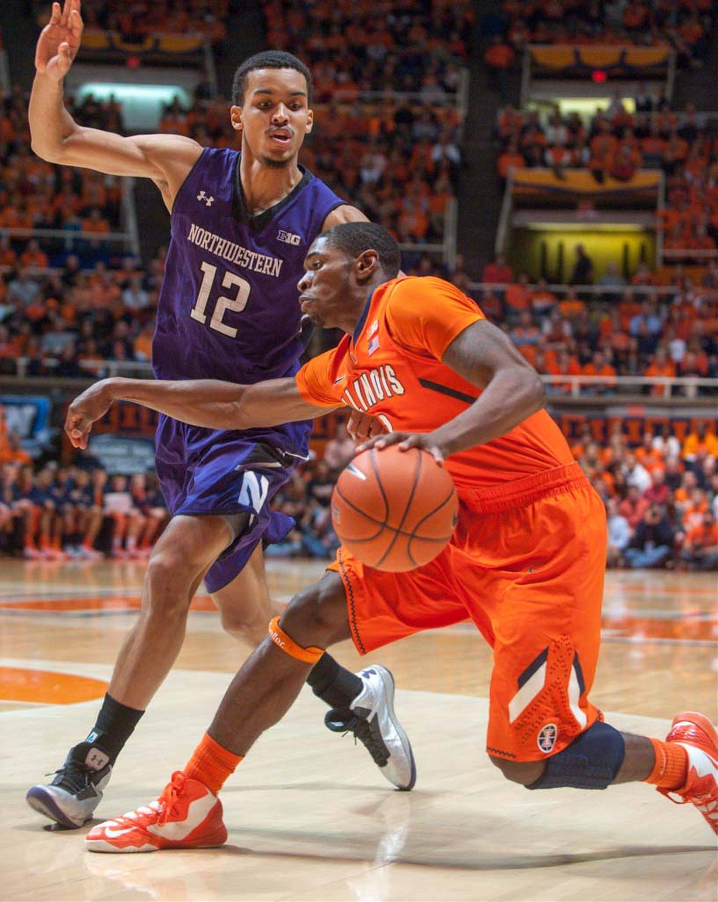 Illinois guard Brandon Paul, right, tries to move past Northwestern forward Jared Swopshire (12) during the first half of an NCAA college basketball game on Thursday, Jan. 17, 2013, in Champaign, Ill. Swopshire is out for the rest of the season after a knee injury.