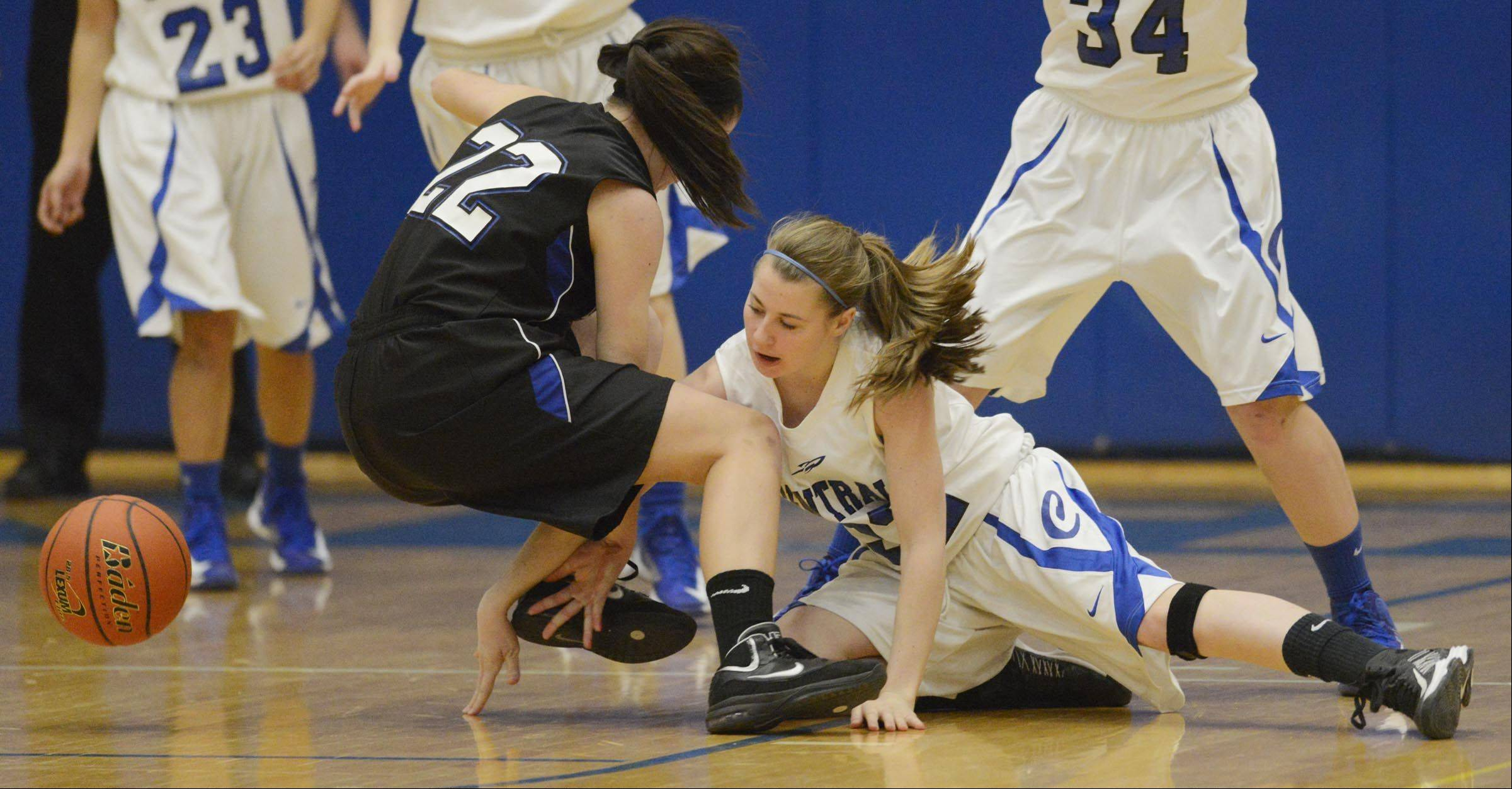 Burlington Central's Aly DeTamble punches the ball away from St. Charles North's Kayla Balousek Tuesday in Burlington.