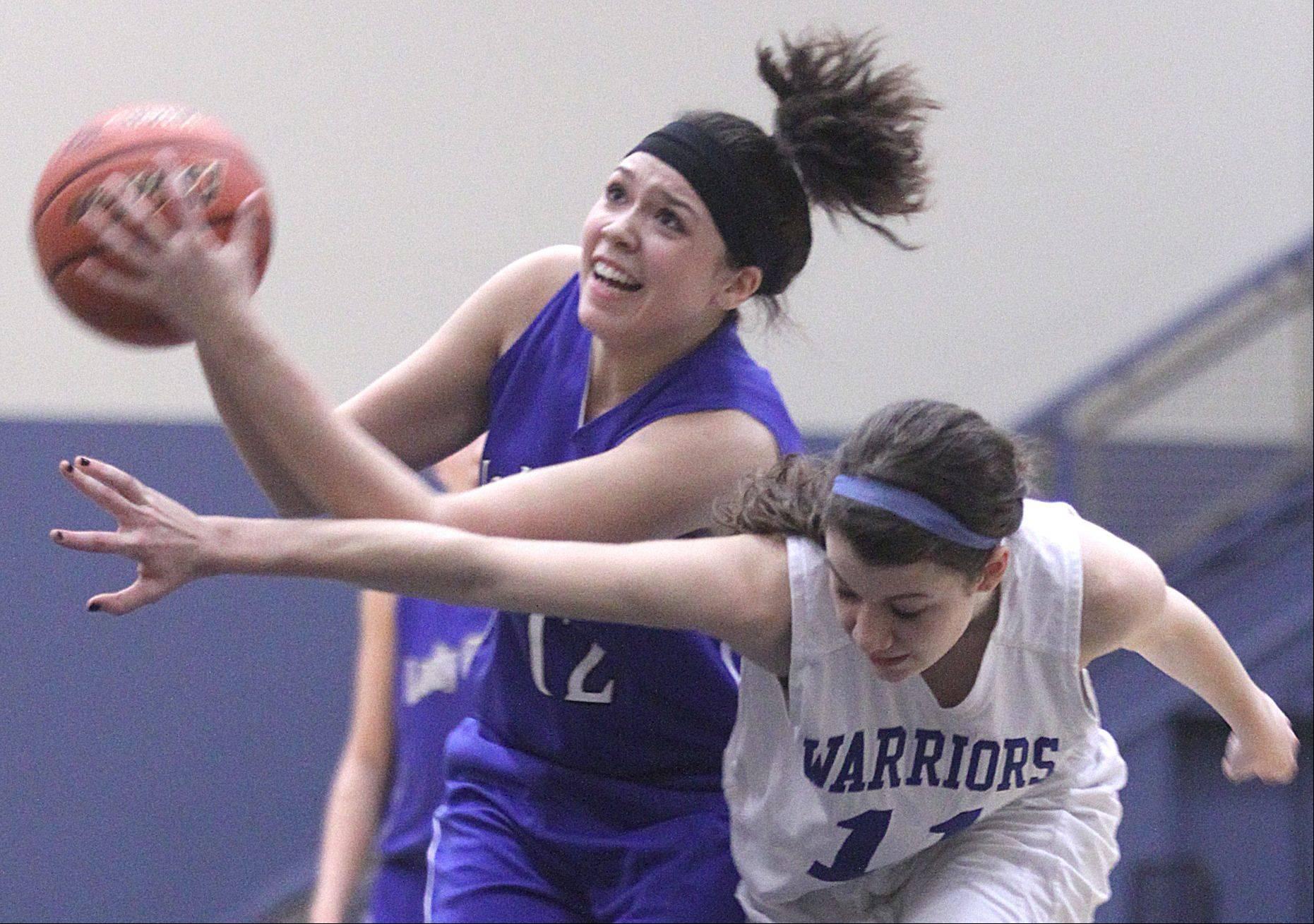 Westminster Christian's Courtney Gnan, right, tries to snag the ball from Christian Liberty Academy's Shelbi Hernandez, left, during Friday's regional championship game at Harvest Christian Academy in Elgin.