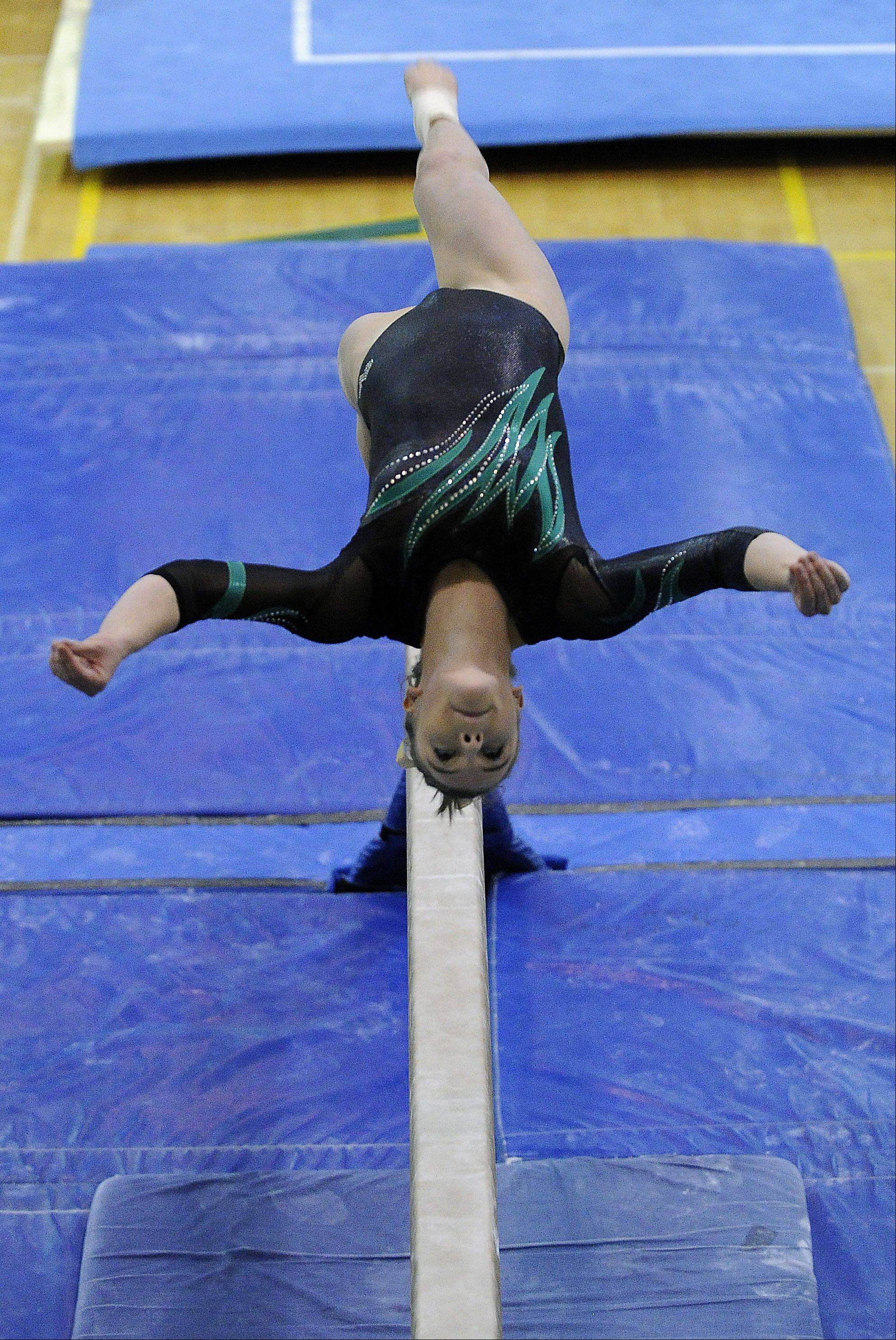 Fremd's Christine Jensen competes on the beam Monday during sectionals at Fremd.