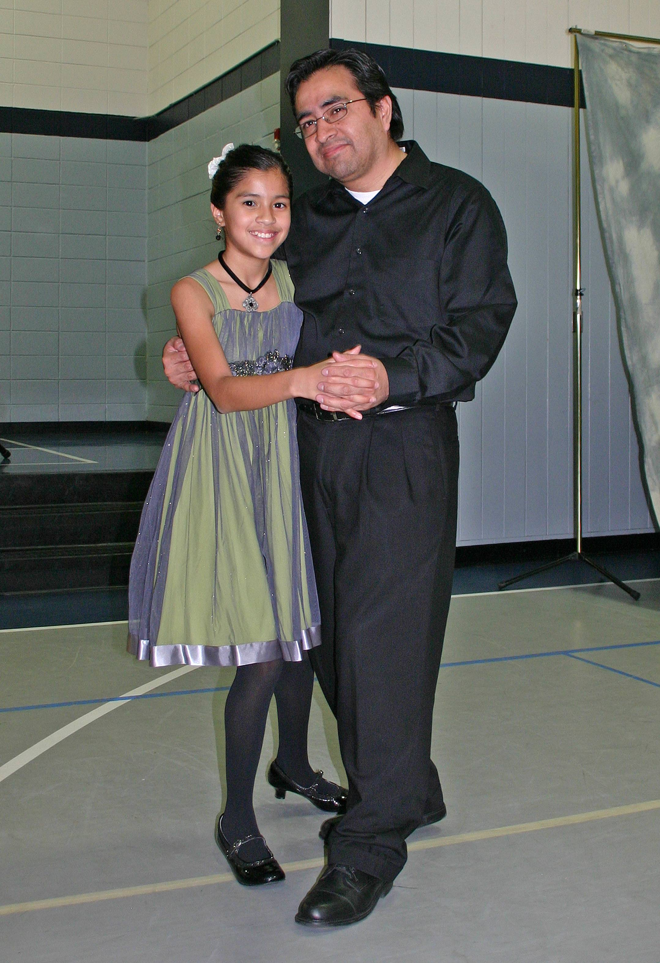 Zophia Perez, 10, shares a special dance with her father, Julio, at the 2013 Father Daughter Royal Ball on February 9.