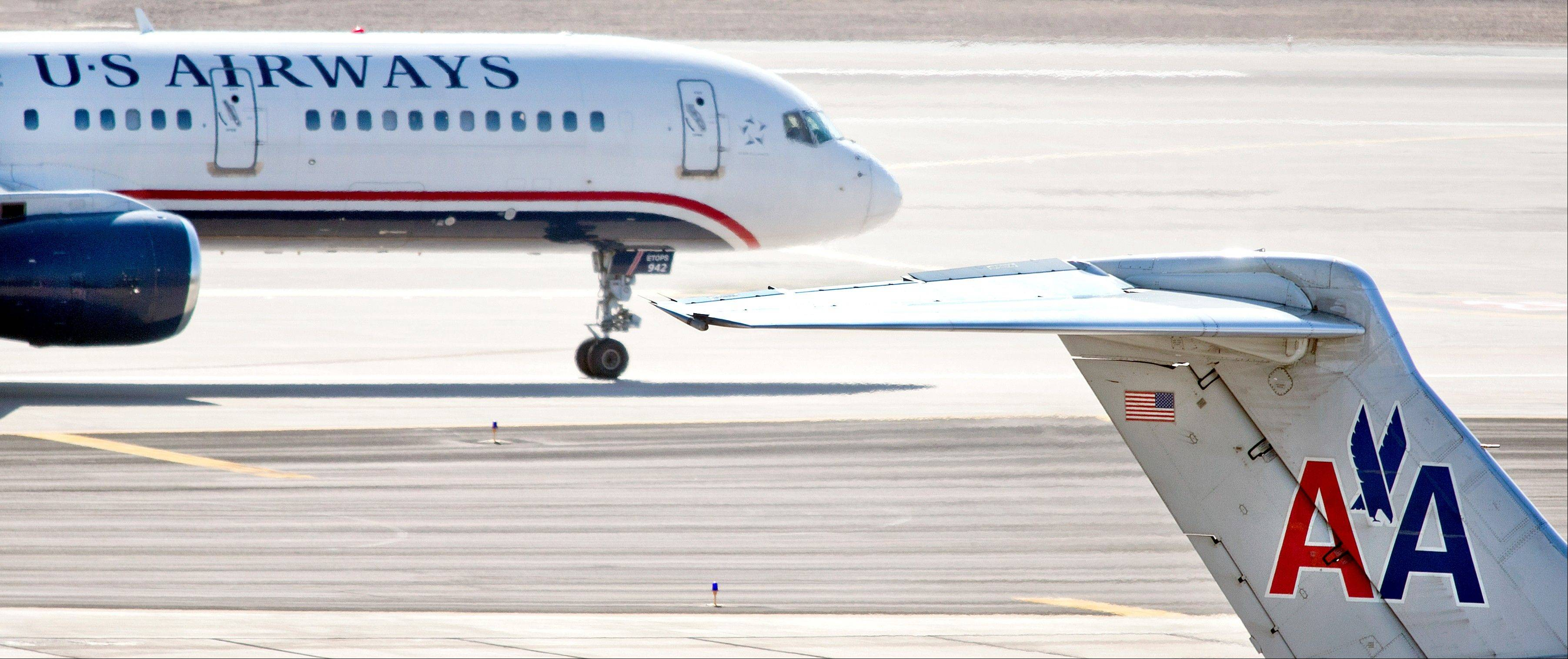American, U.S. Airways announce $11 billion merger