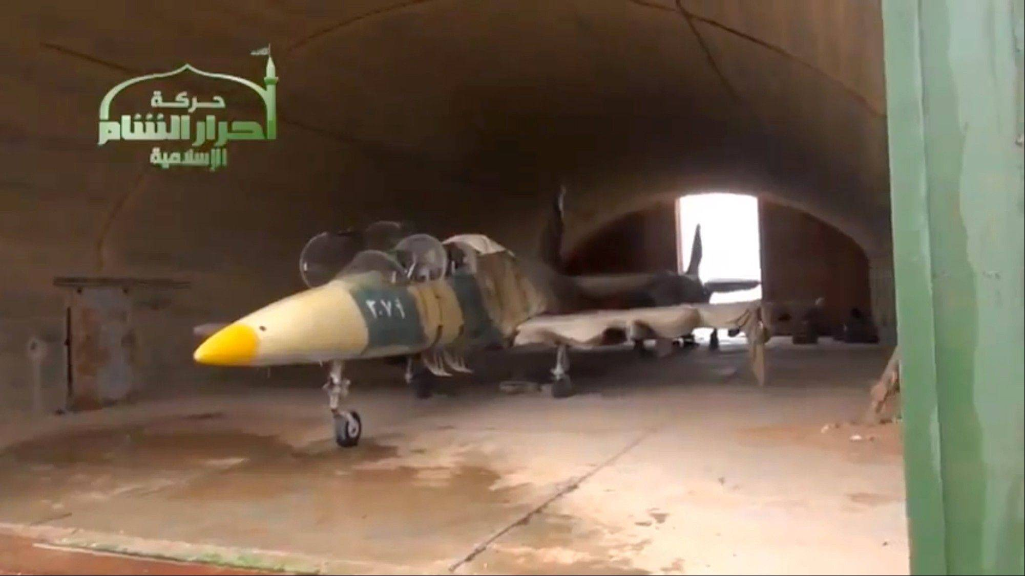 A Syrian fighter jet in a hangar at Jarrah airfield in Aleppo province, which was captured by rebels on Tuesday, their second major strategic victory in as many days, activists said.