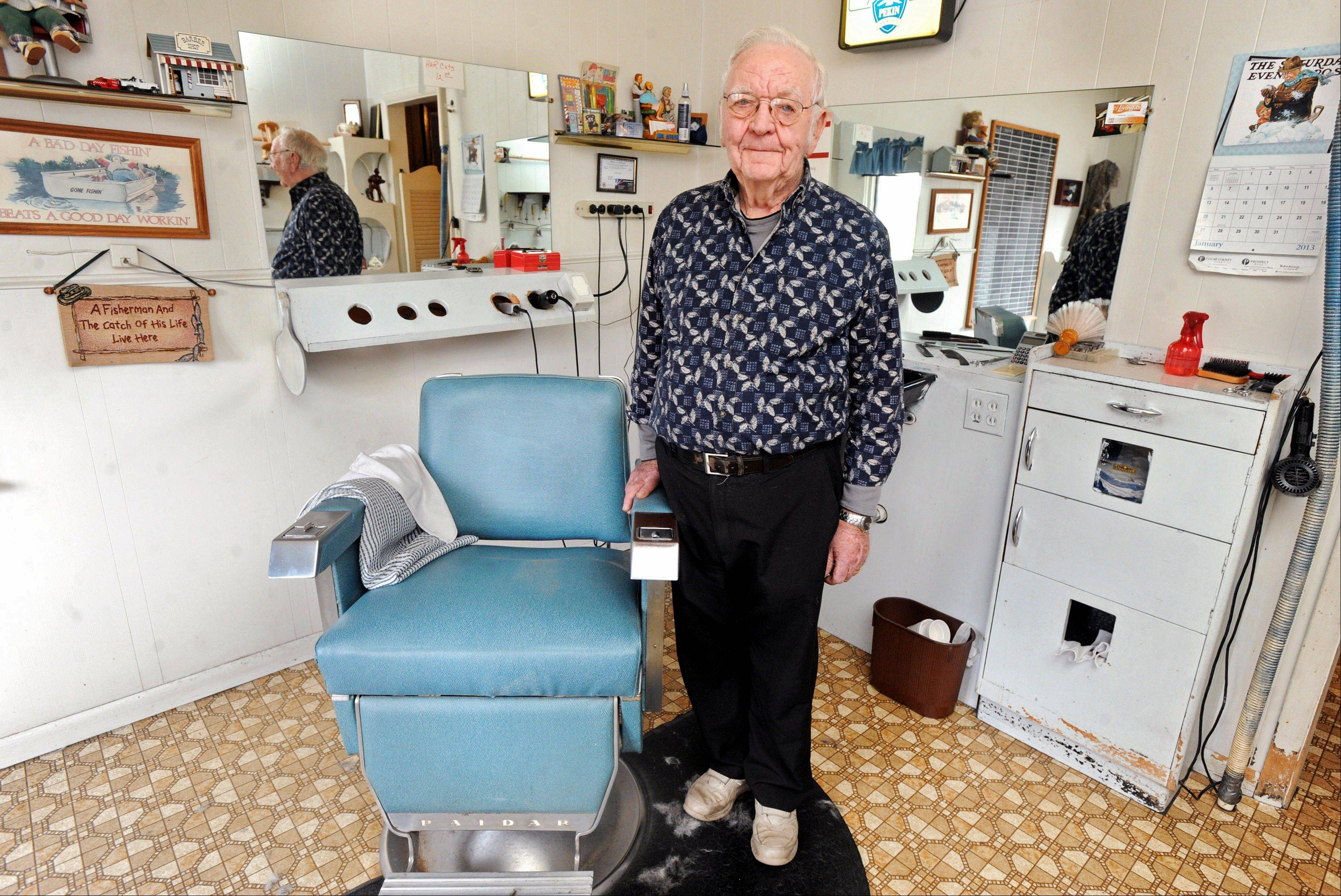 Roy Carr at Roy and Ruth�s Barber & Beauty Shop in Oakland, Ill.