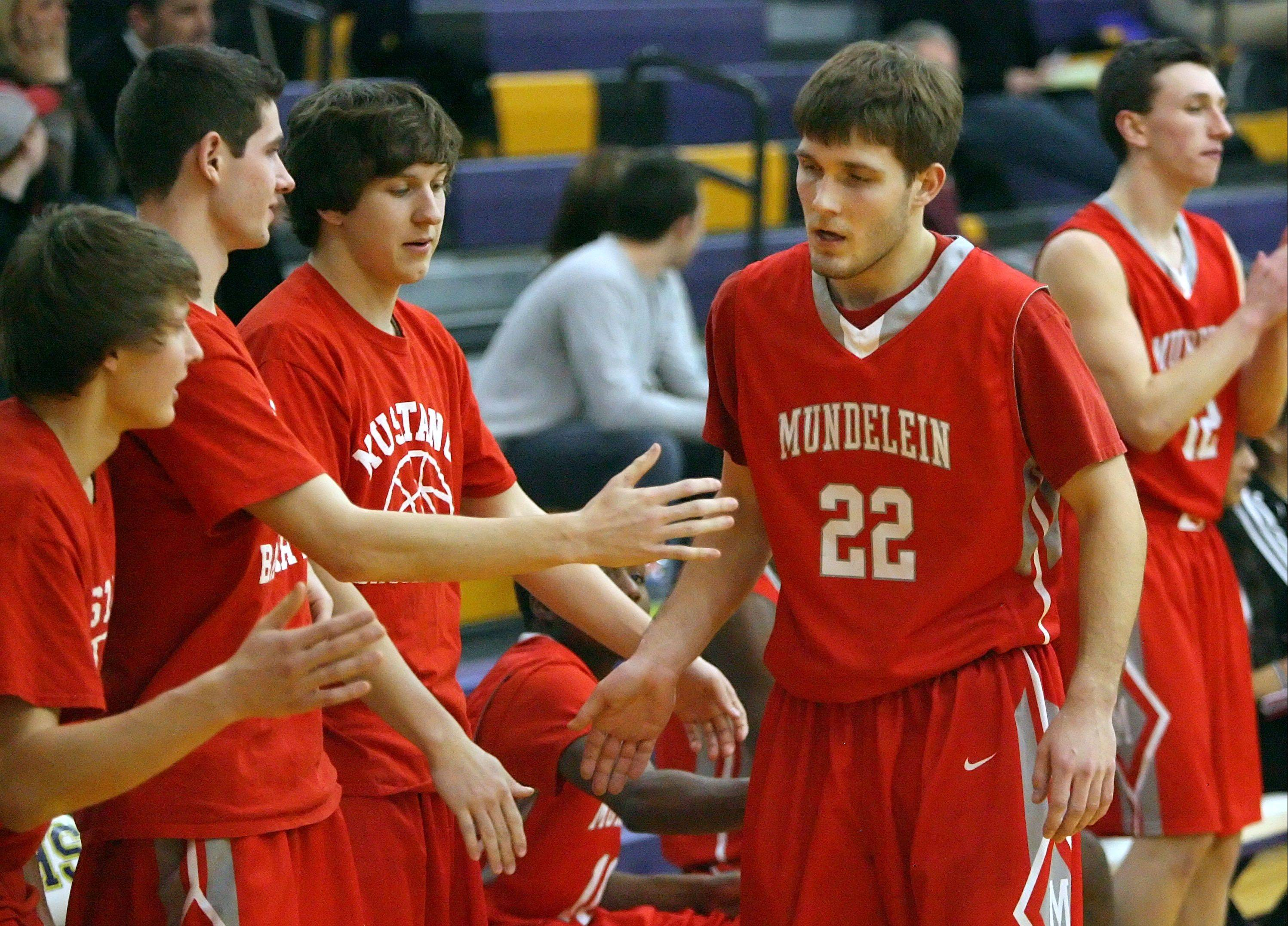 Mundelein�s Robert Knar gets high-fives from the bench after breaking the all-time Mundelein scoring record held by Kyle Kessel on Wednesday night at Wauconda.