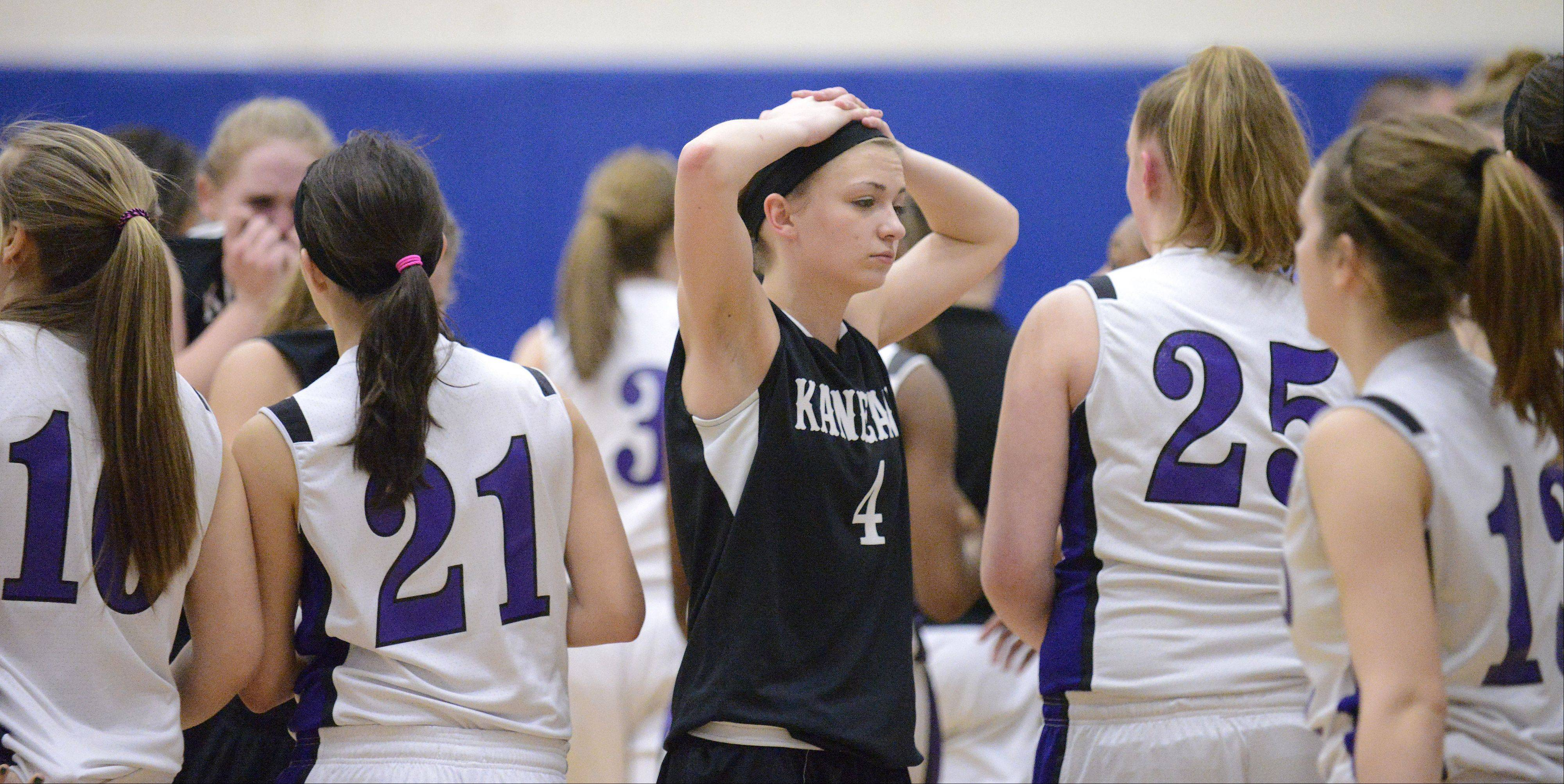 Kaneland�s Caroline Heimerdinger makes her way through Plano players after the Knights� loss.