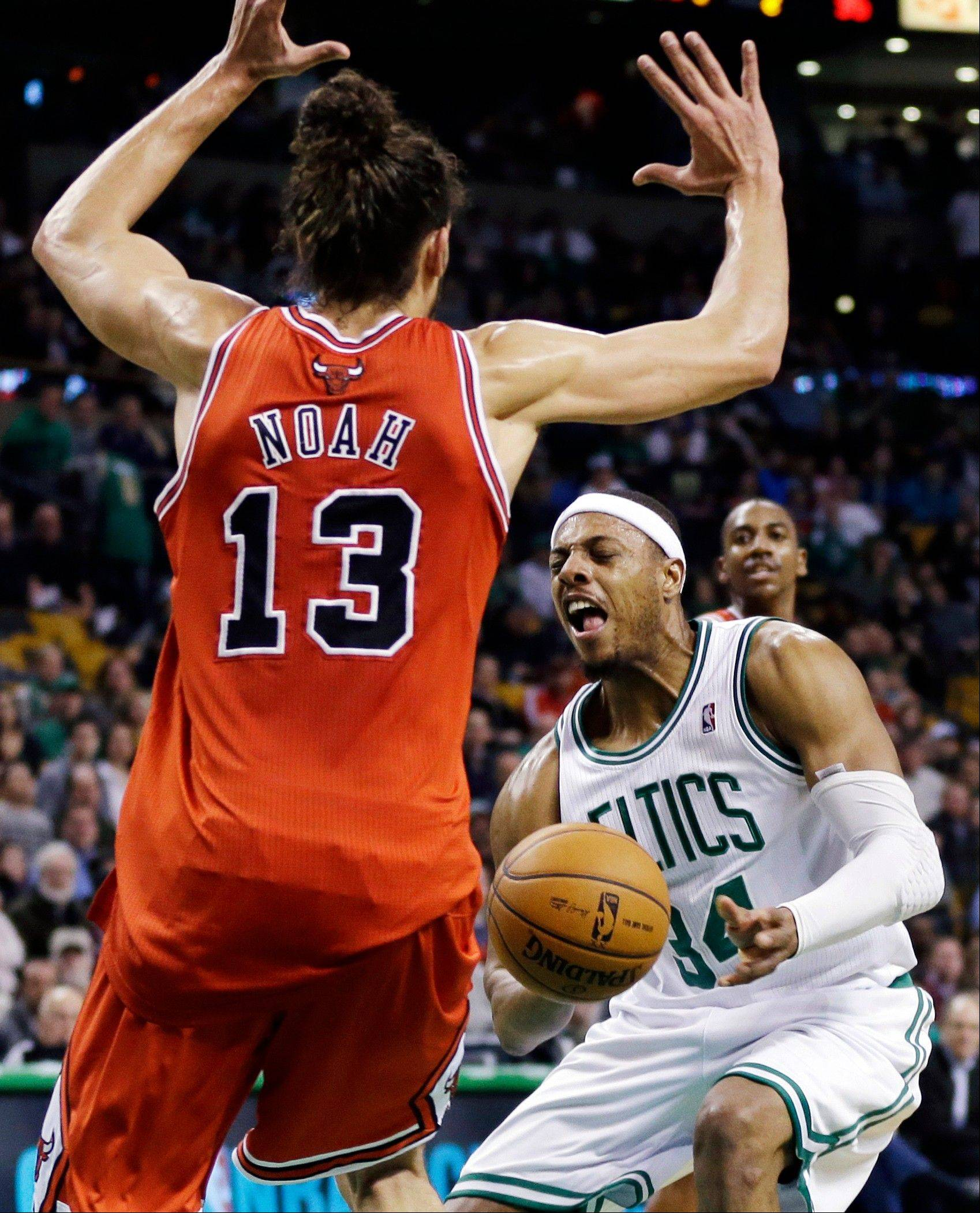 Bulls center Joakim Noah, who played 43 minutes on a sore right foot, defends against the Celtics' Paul Pierce on Wednesday night.