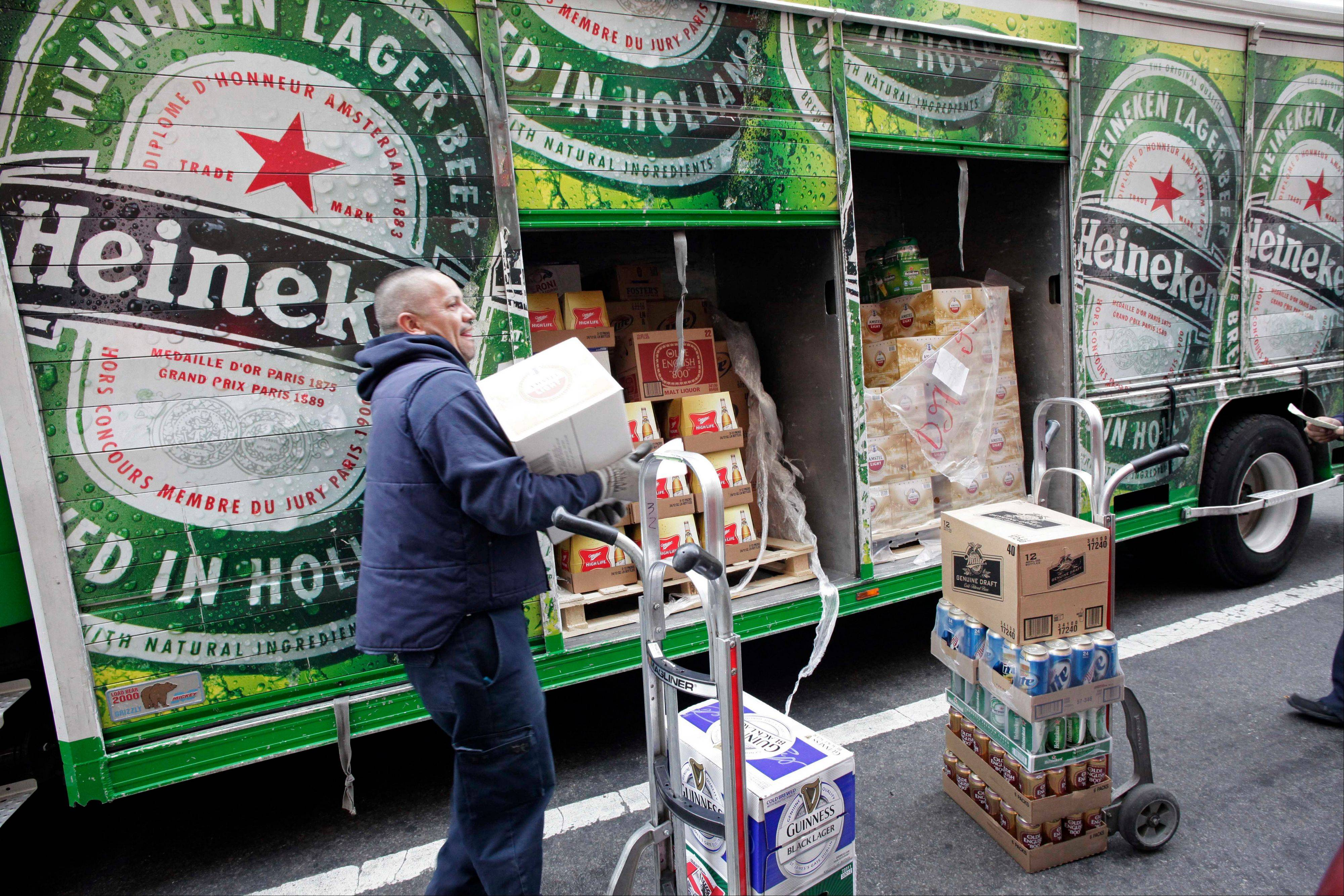 Heineken NV, the world's third- biggest brewer, reported full-year earnings that beat estimates as cost savings offset weaker beer shipments in western Europe.