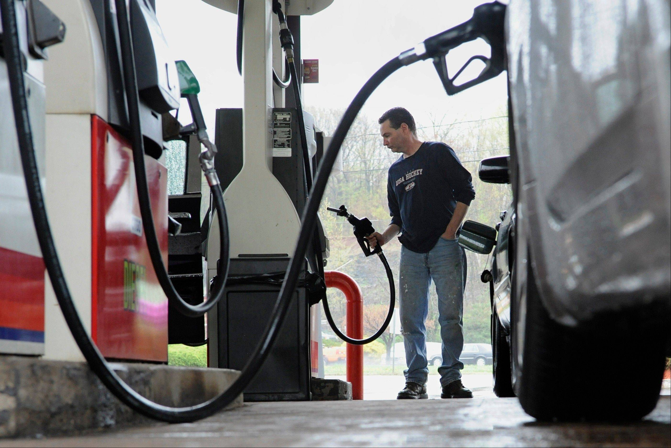 First it was a tax hike. Now consumers are looking at a higher than expected gasoline bill for 2013. The government on Tuesday boosted its forecast for gasoline prices this year by 11 cents to an average of $3.55 a gallon.