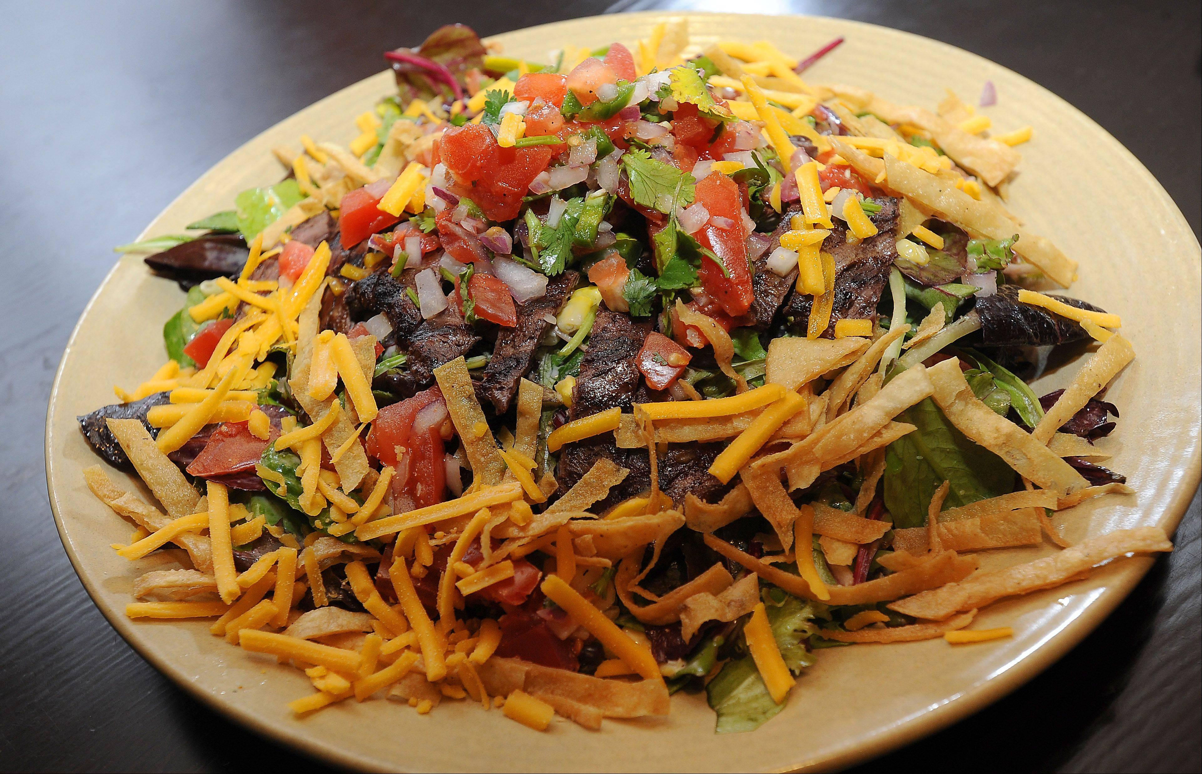 The Southwest steak salad is one of many menu options at McMae's Tavern & Grill in Bartlett.