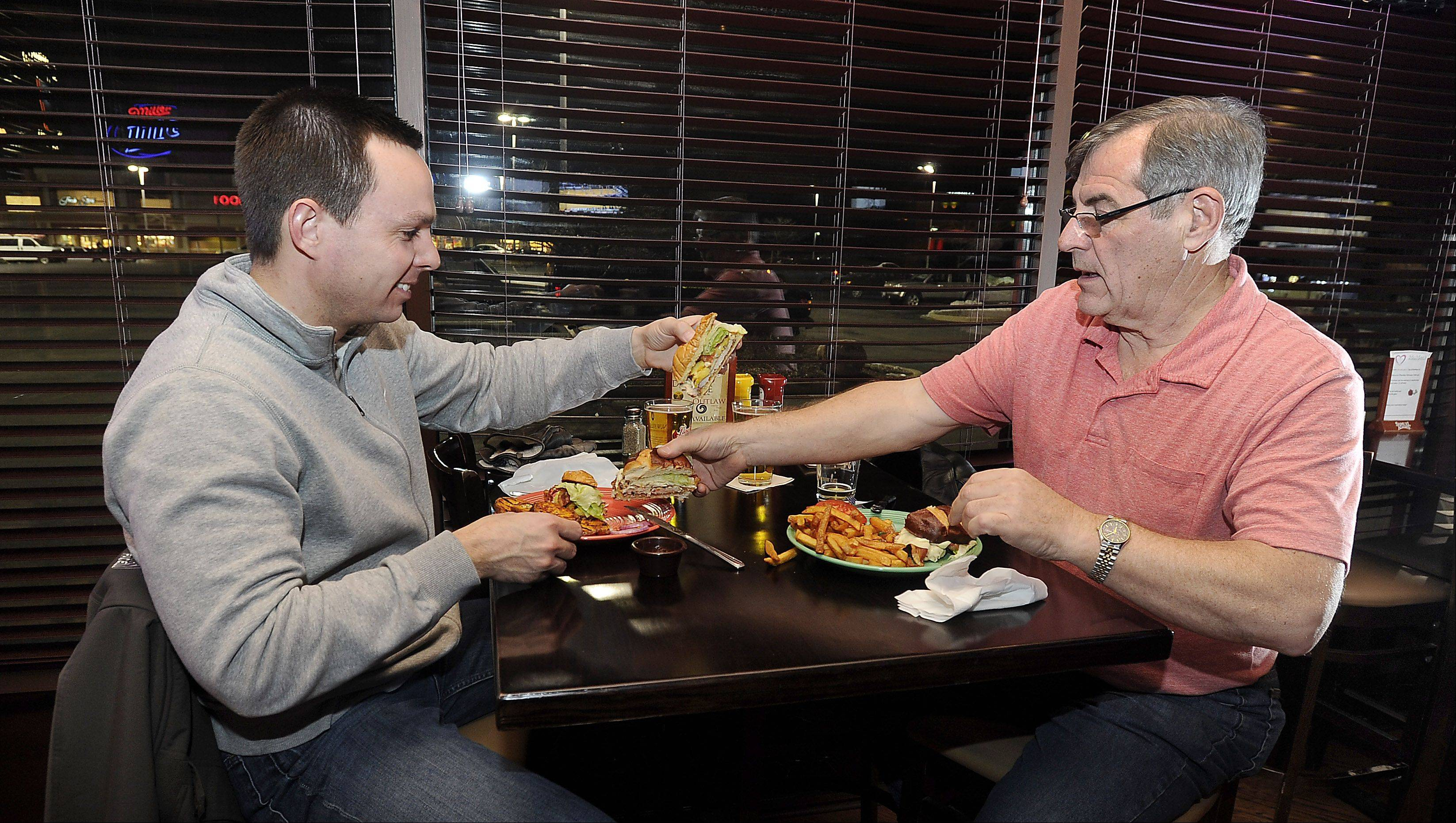 Tim Murphy and Bill Gillespie of Bartlett dig into the black and blue burger at McMae's.
