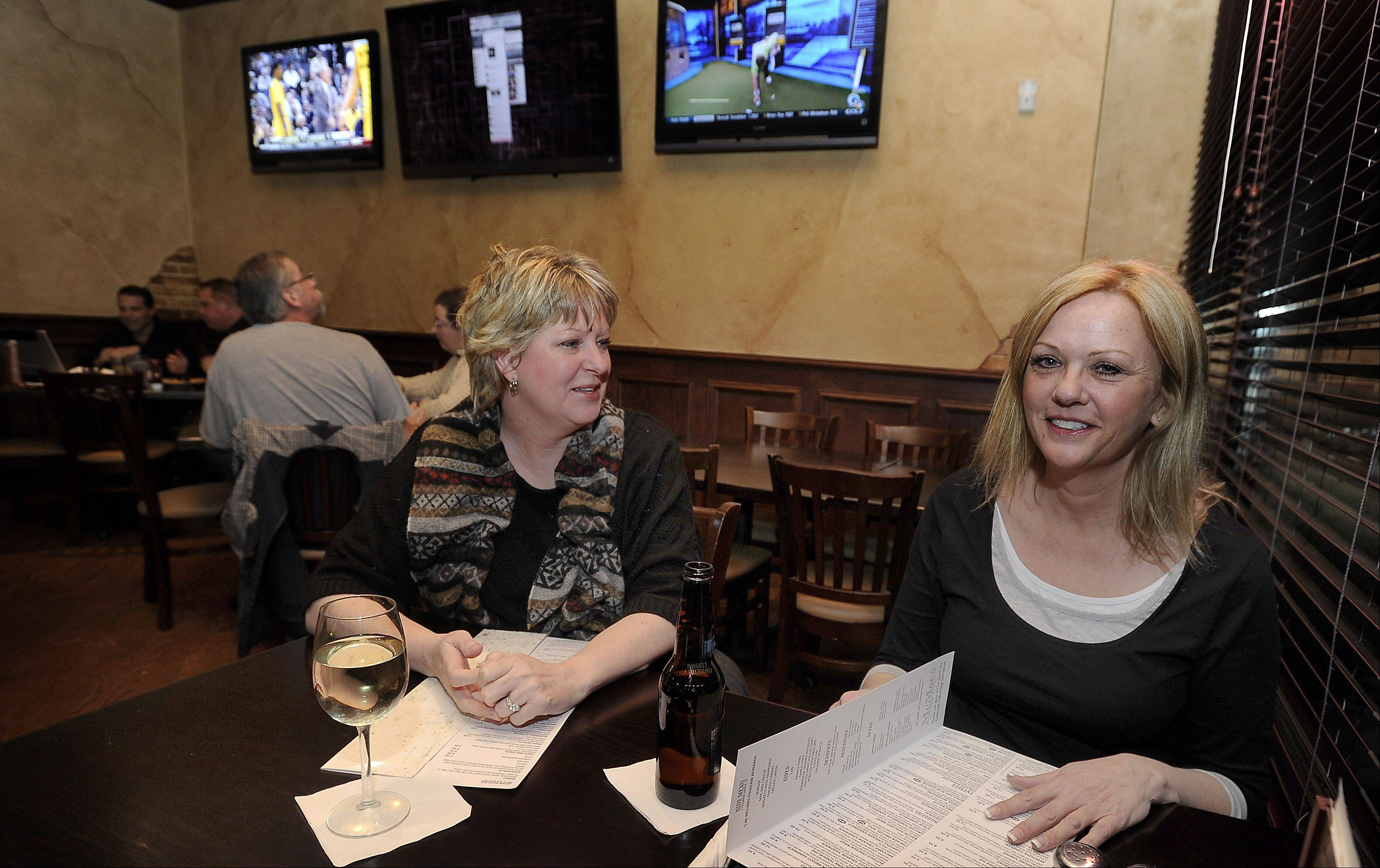 Nancy Fachie, left, and Sue Mullin of Bartlett enjoy wine before dinner at McMae's in Bartlett.