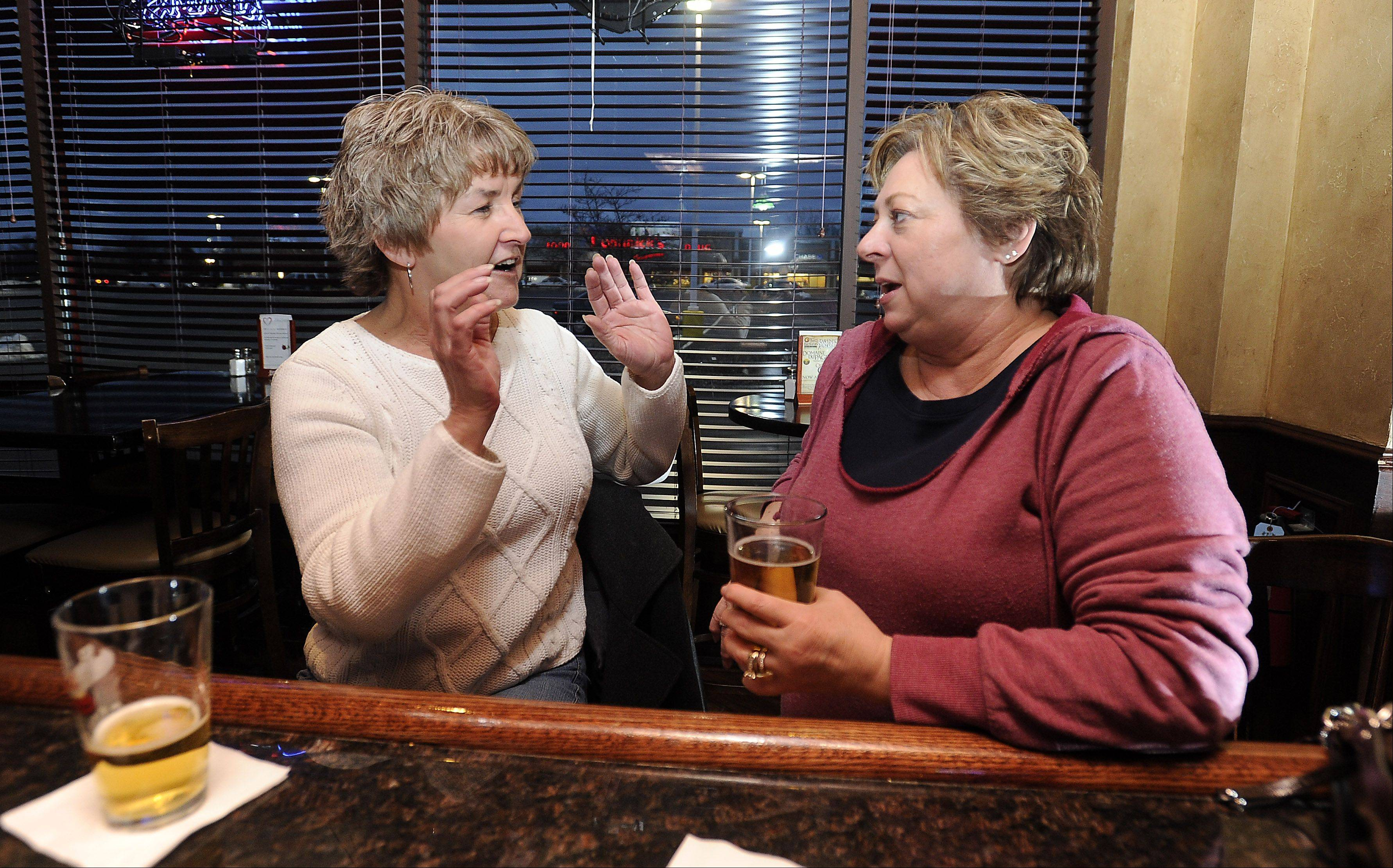 Jackie Fish, left, of DeKalb has a drink with her friend Sue Dierking of Bartlett at McMae's Tavern & Grill in Bartlett.