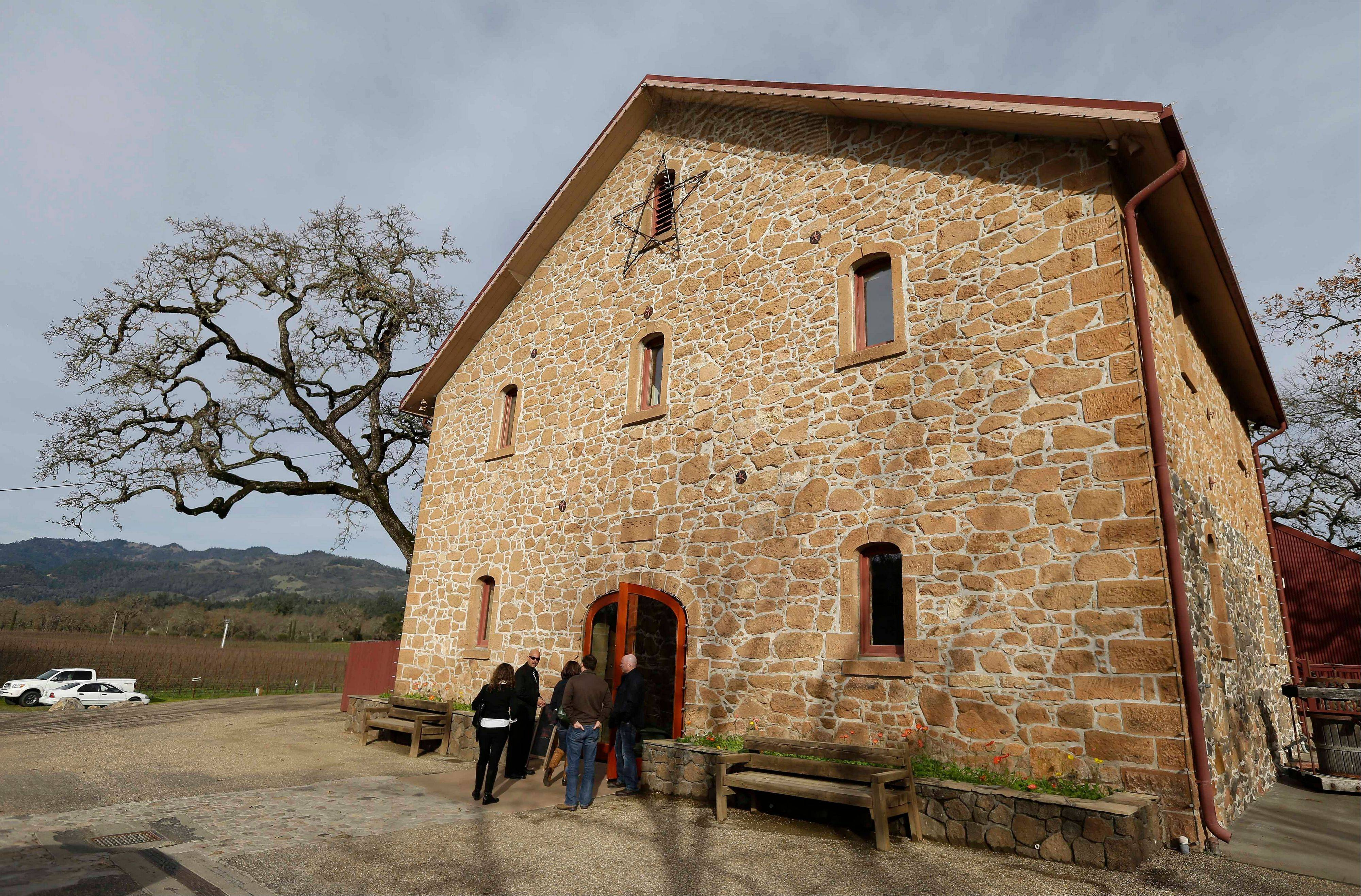 Visitors make their way into the stone winery building dating to 1886 at Ehler's Estate in St. Helena, Calif. Proceeds from the winery's sales go to the Leducq Foundation which continues to award more than $30 million annually to directly support international cardiovascular research.