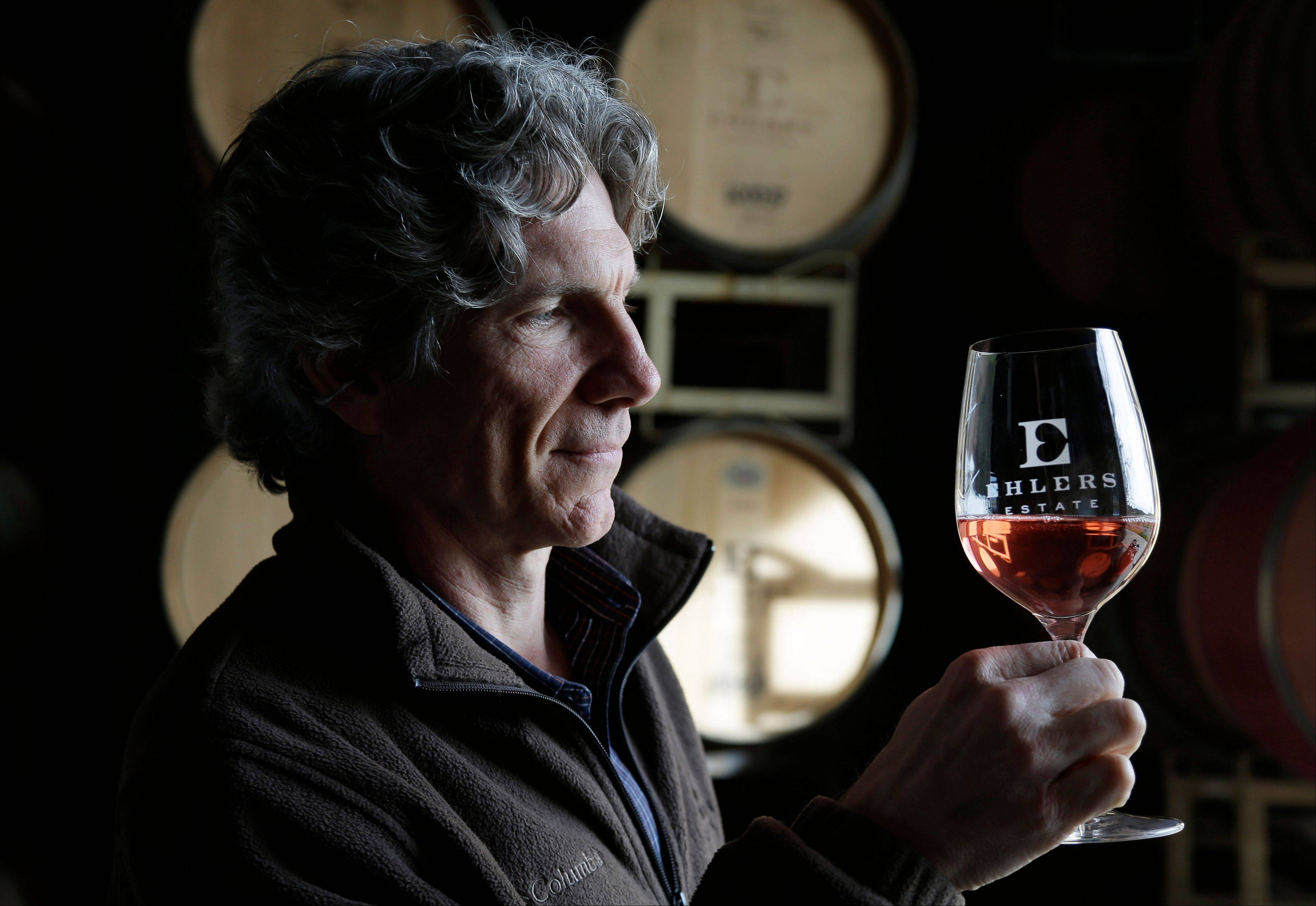 Winemaker Kevin Morrisey looks over a sample of Ros� from a barrel at Ehler's Estate in St. Helena, Calif.