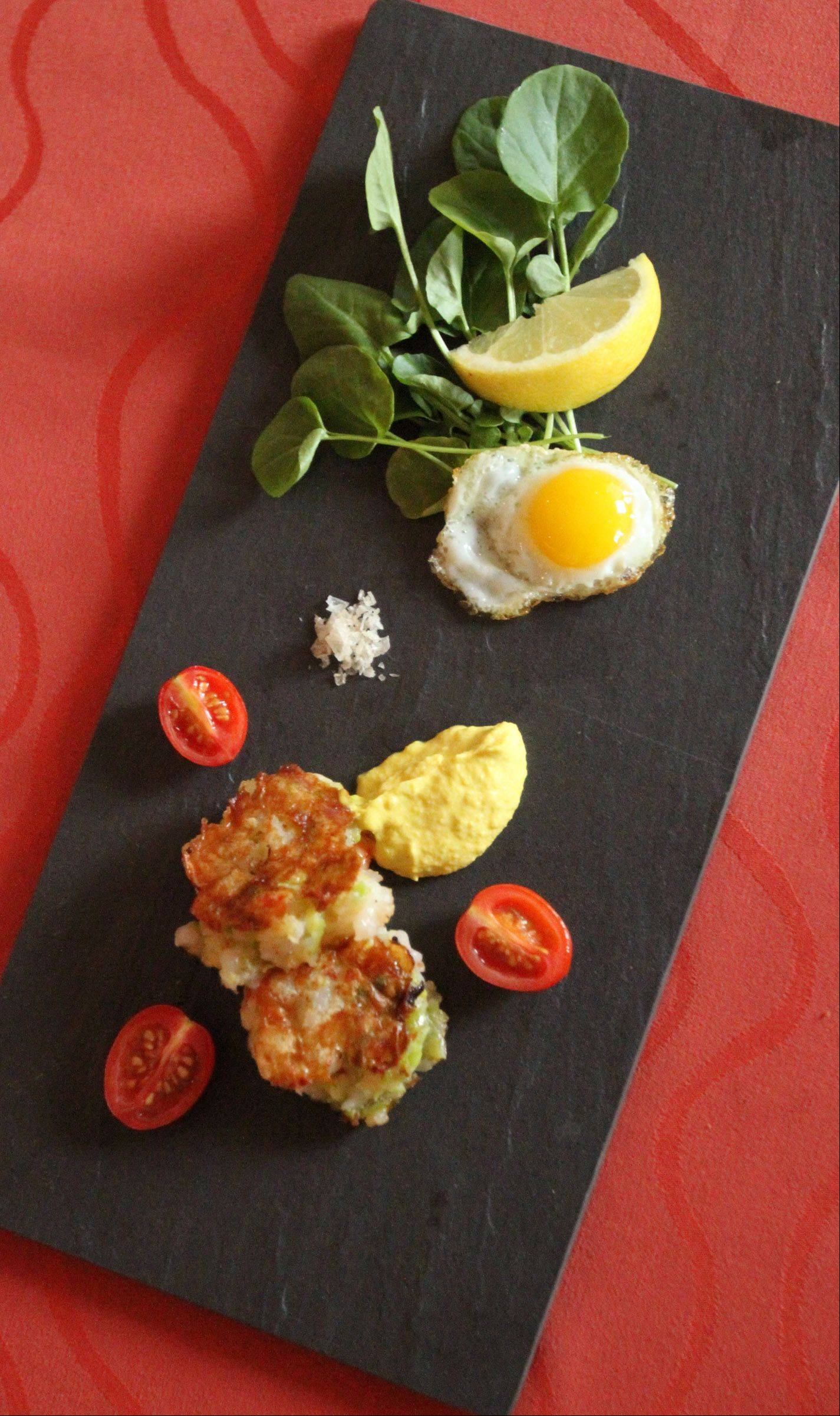 Don't leave Fresco 21 without trying shrimp and leek cake, quail egg, sweet corn curry dressing and watercress.