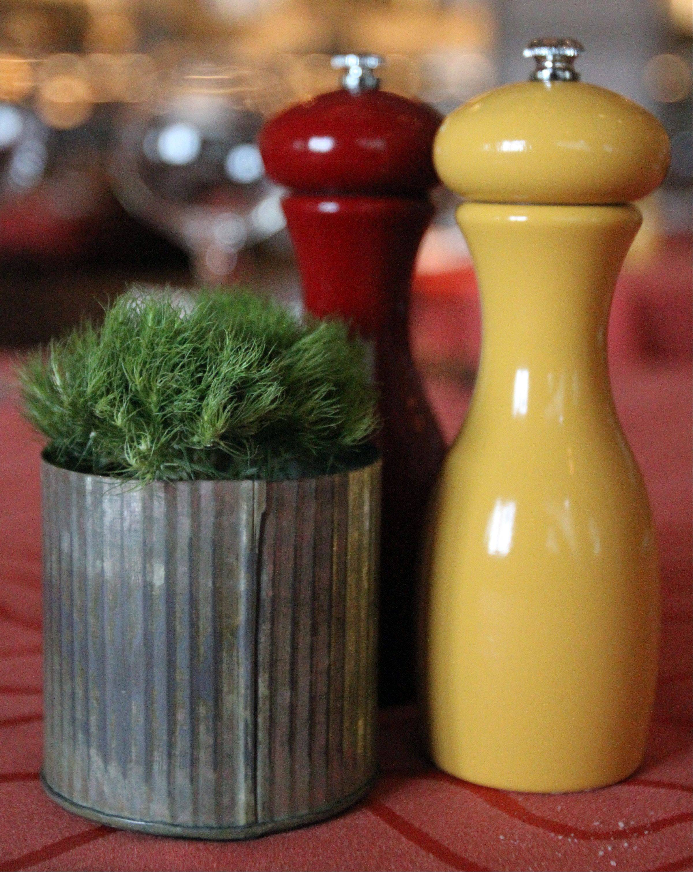 Salt, pepper and greenery decorate the tables at Fresco 21.